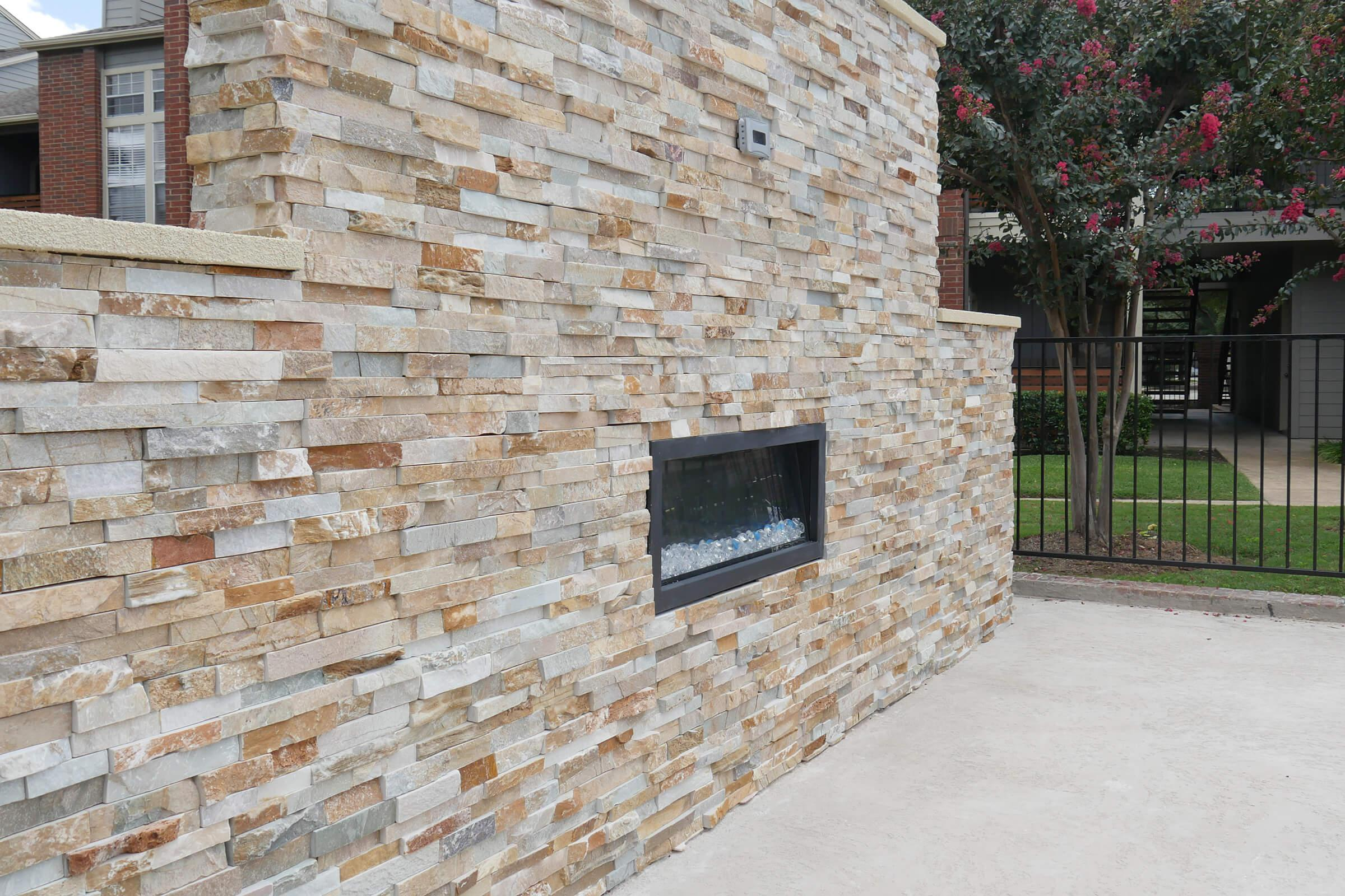 a fireplace in front of a brick building