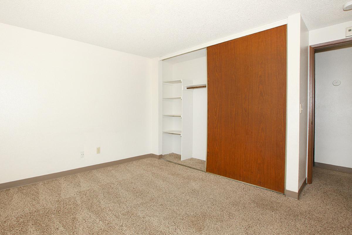 a bedroom with a wooden door