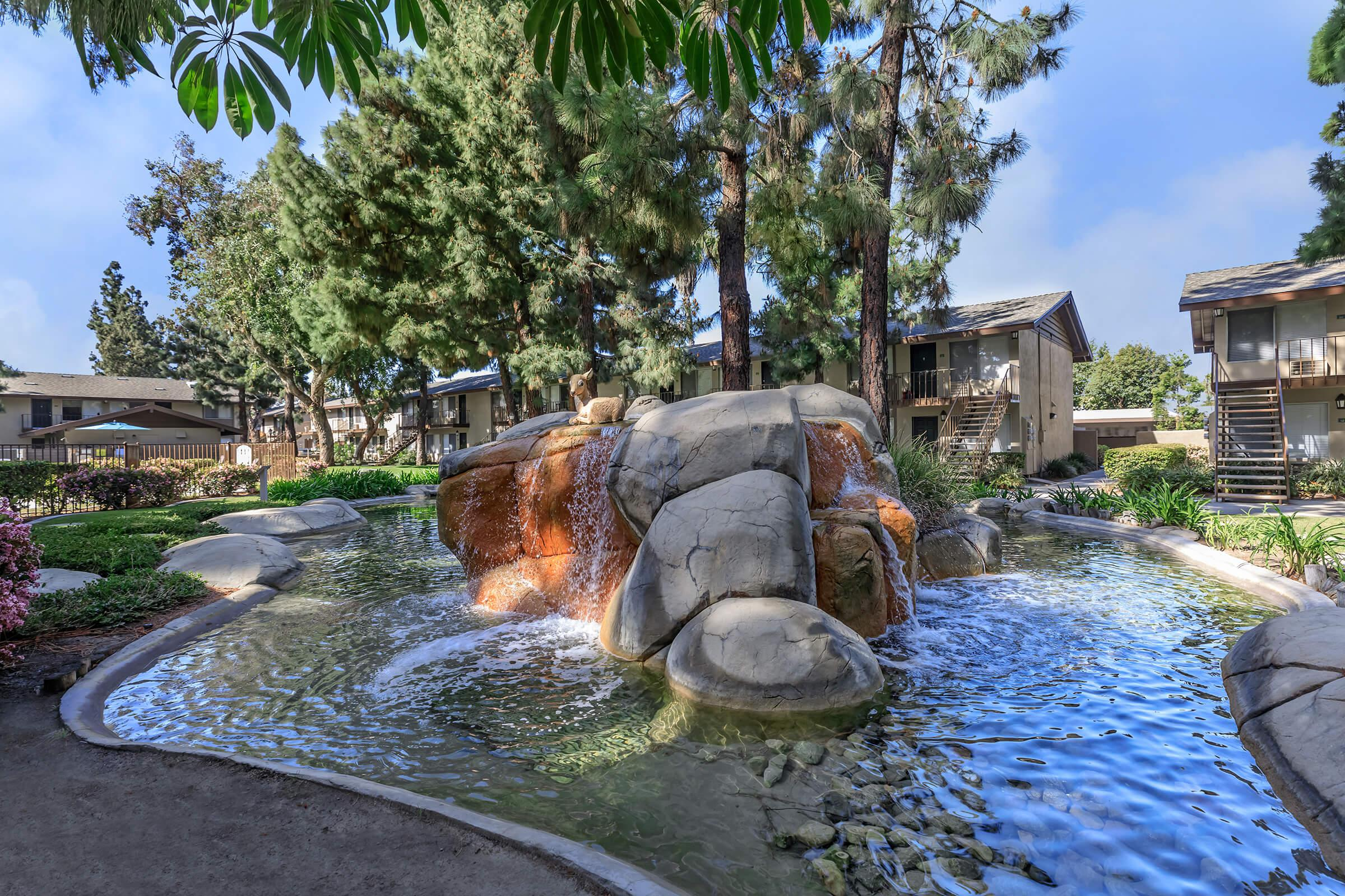 Water feature surrounded by community buildings