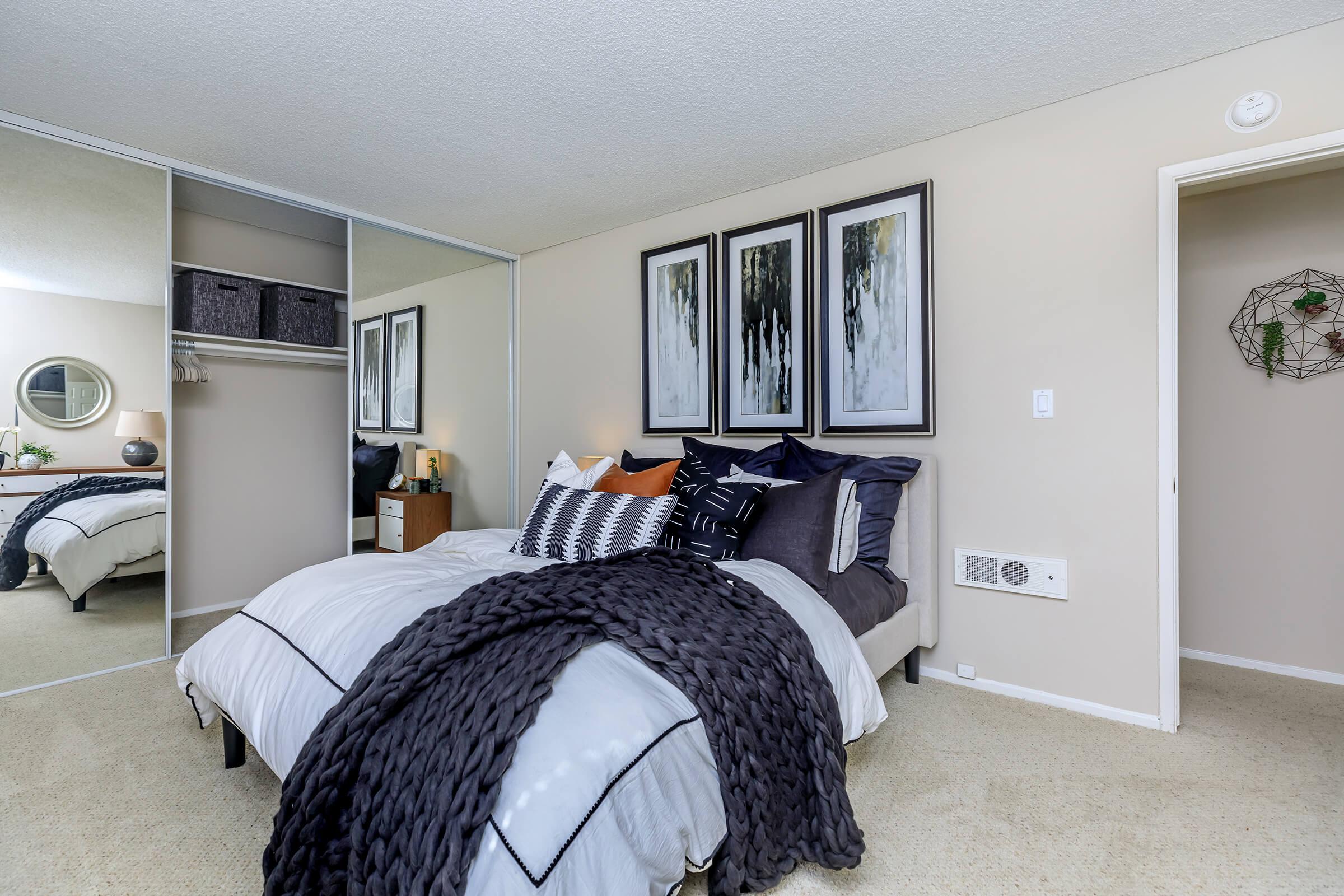 Bedroom with sliding glass mirror closet doors