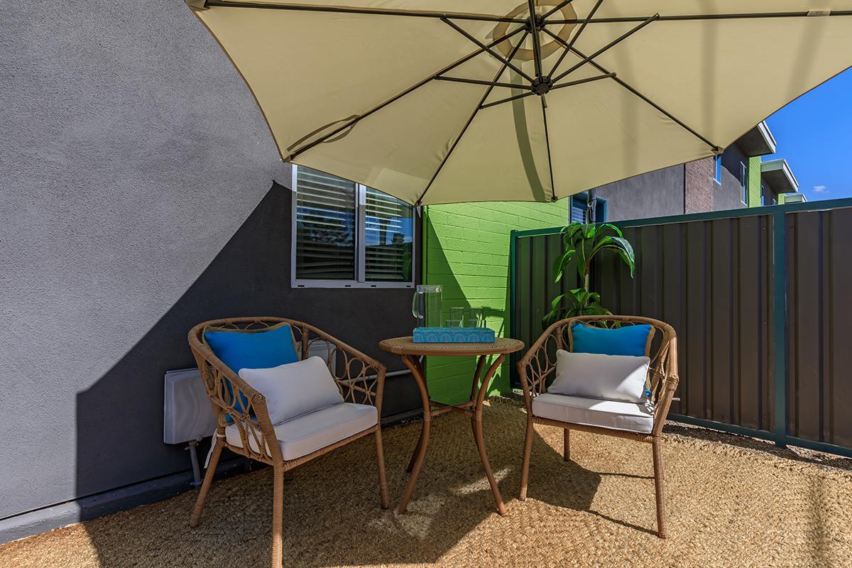 a room with a green umbrella