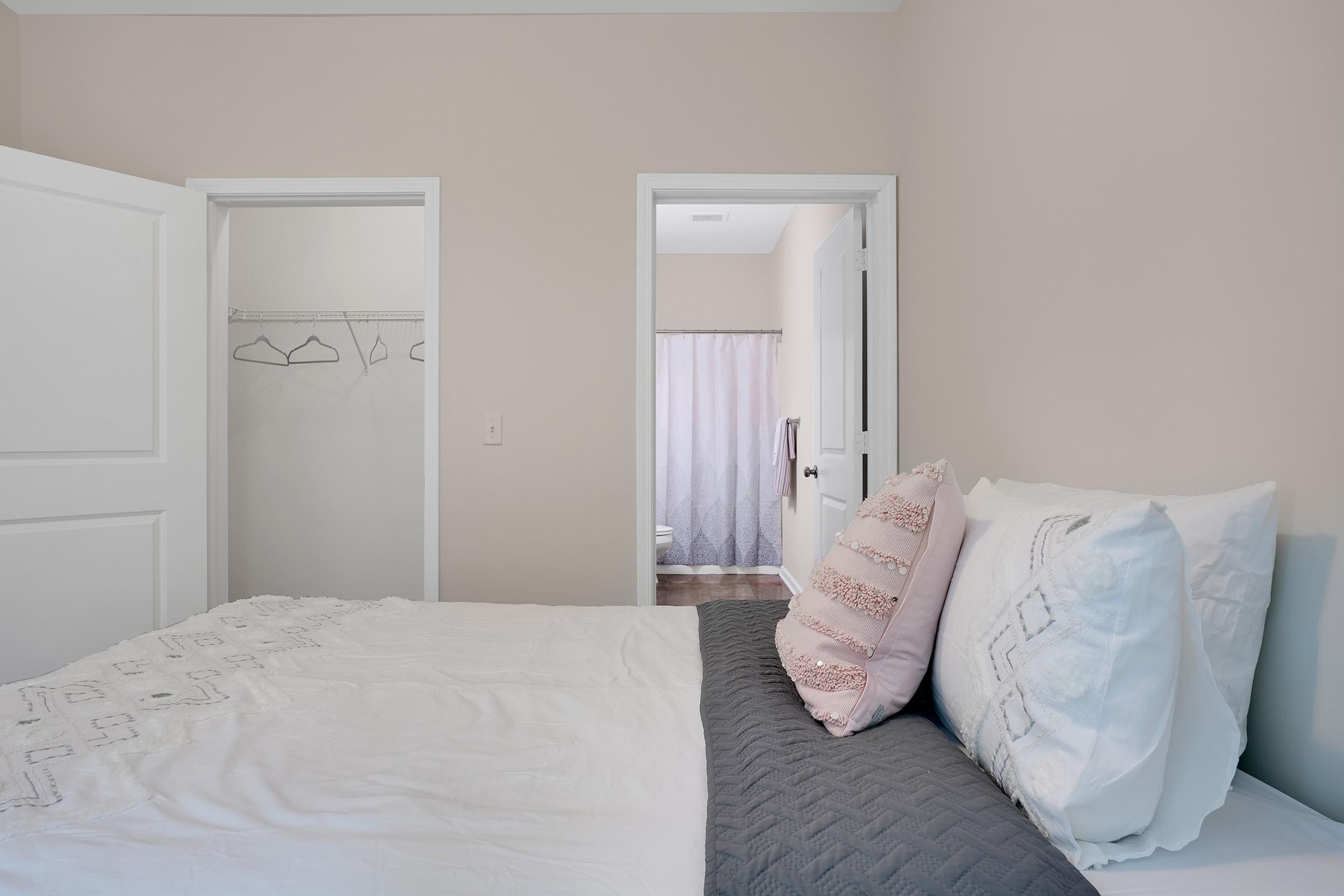 a large white bed sitting in a room