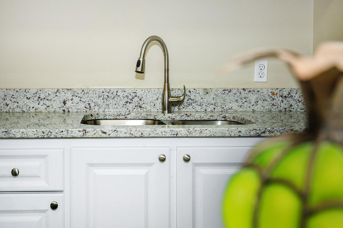 a close up of a sink in a kitchen