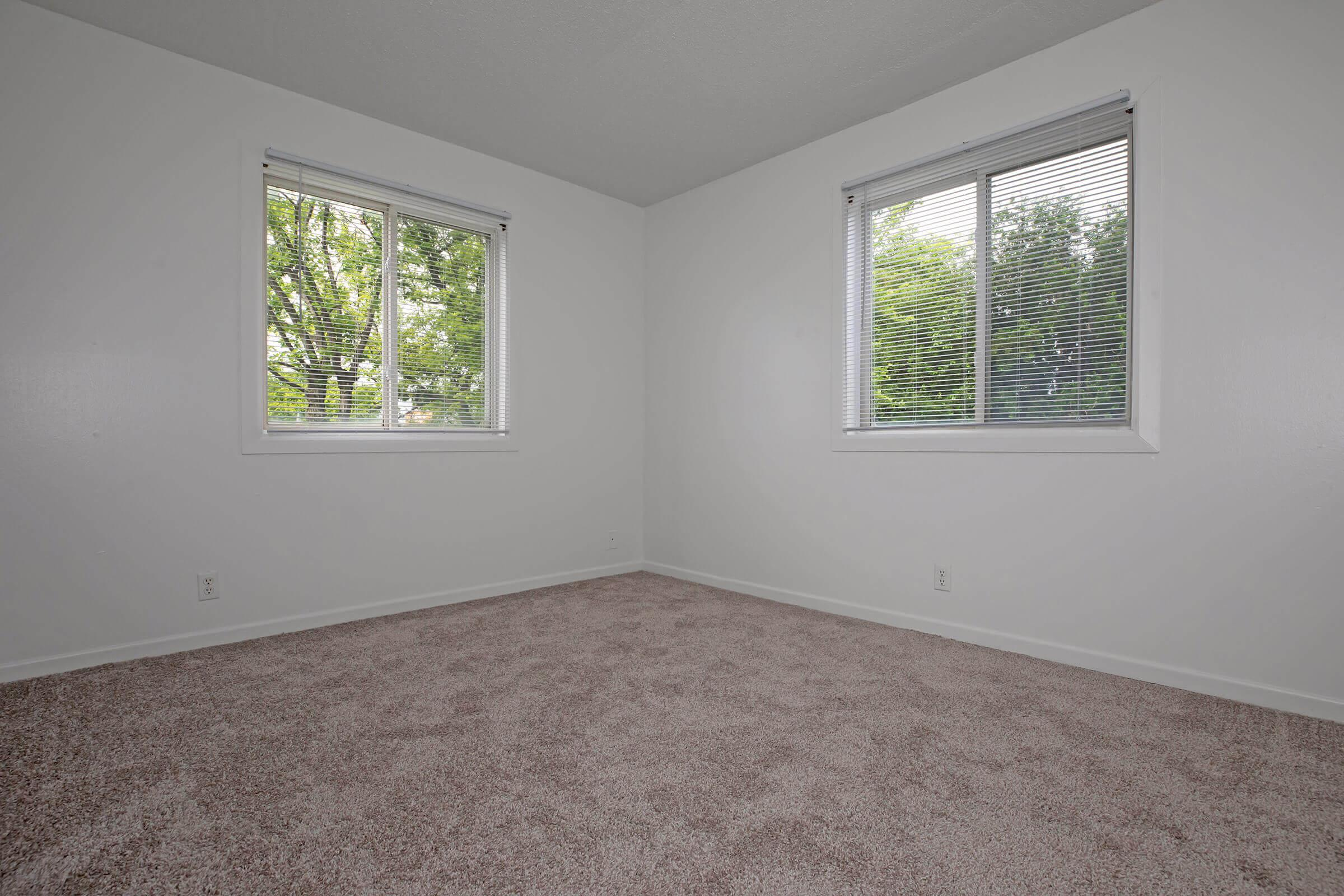 a room with a bed and a window