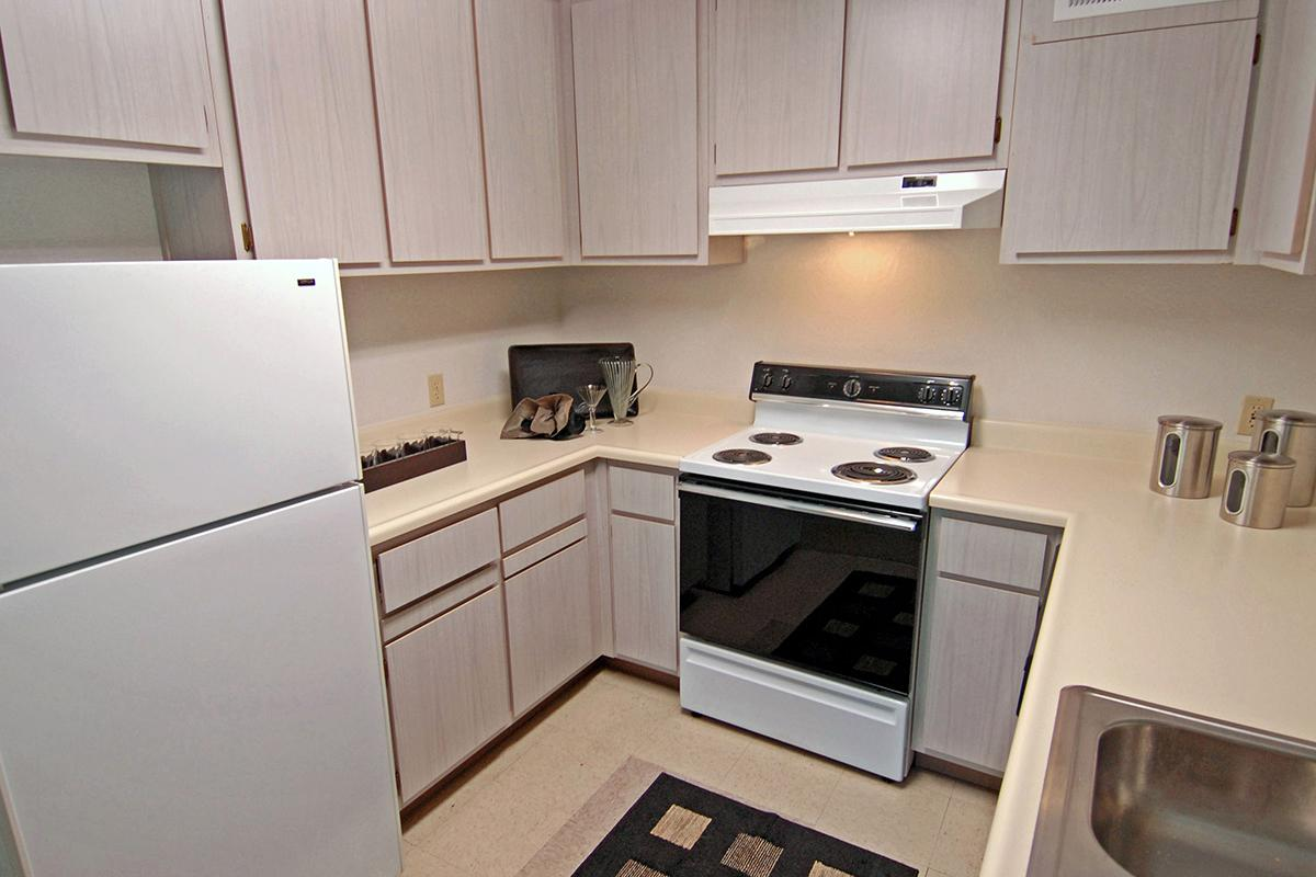 a kitchen with a white microwave oven sitting on top of a stove