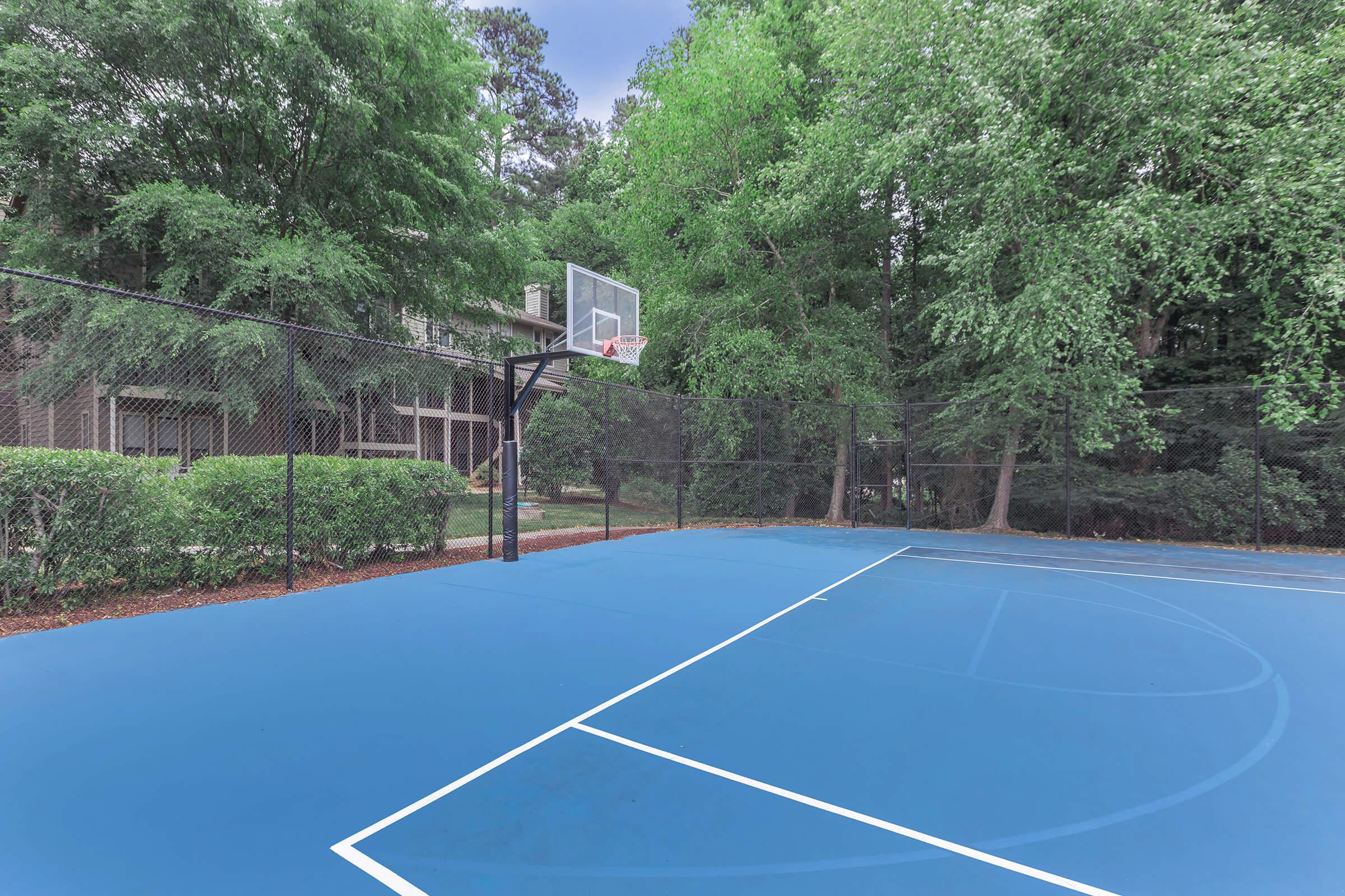 a basketball on a court with a racquet