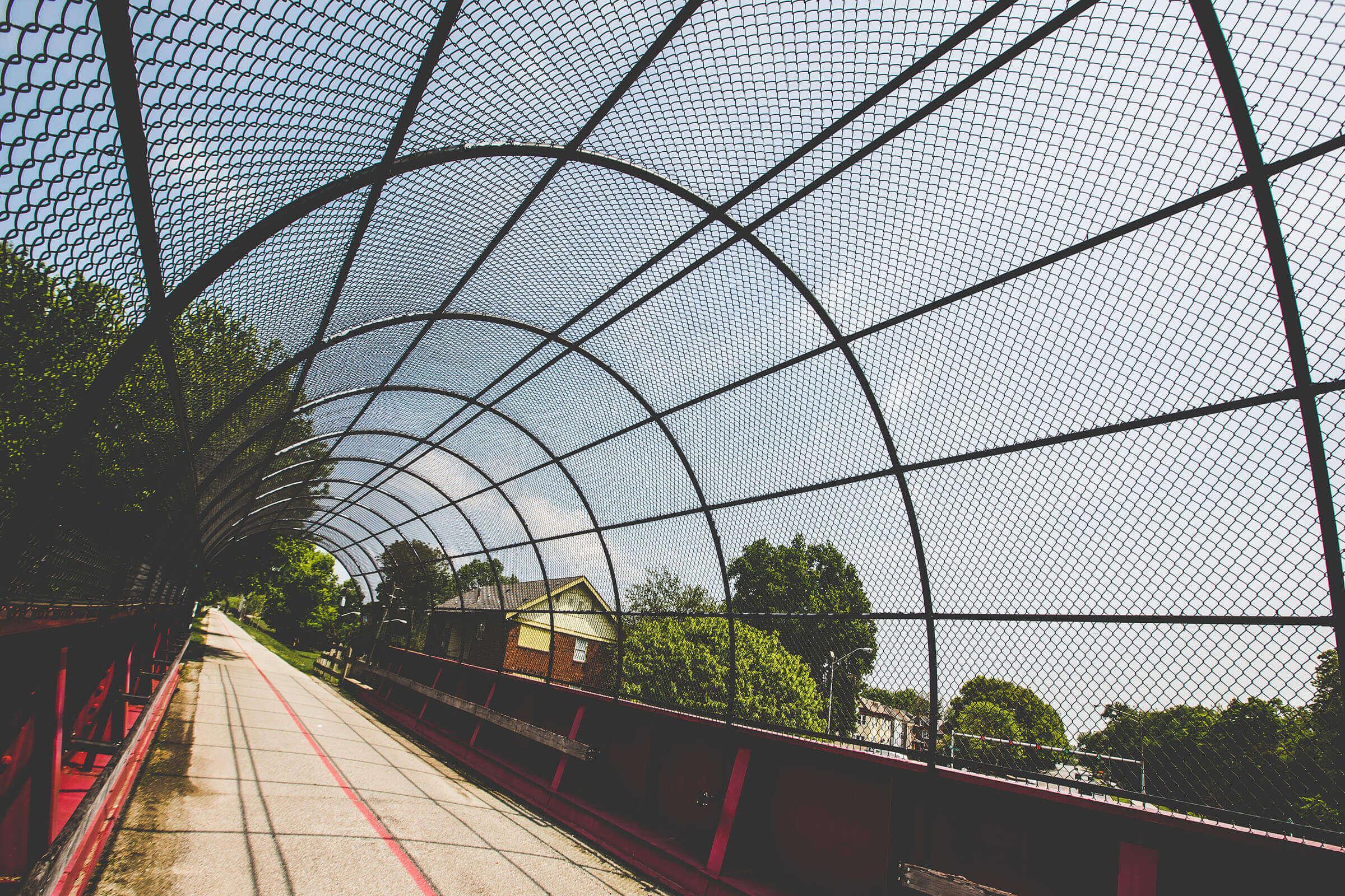 a train on a track near a fence