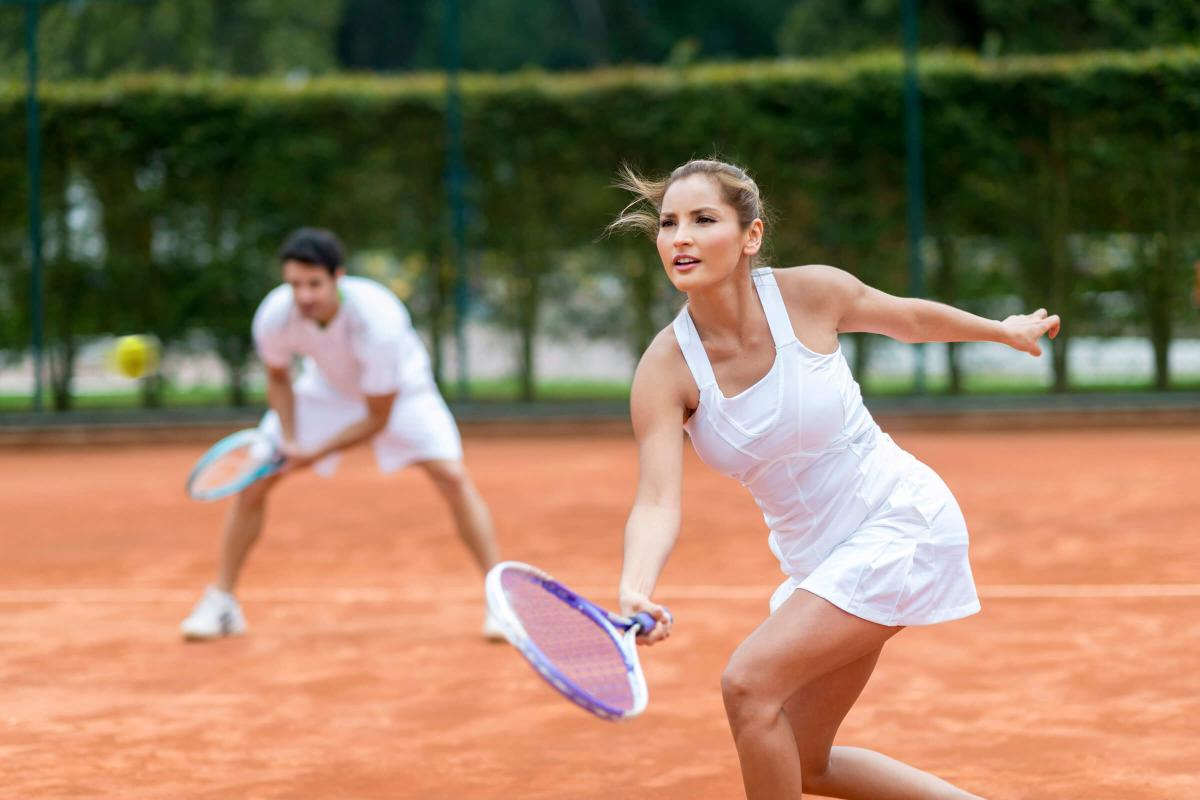 Couple playing tennis iStock_41472452_LARGE.jpg