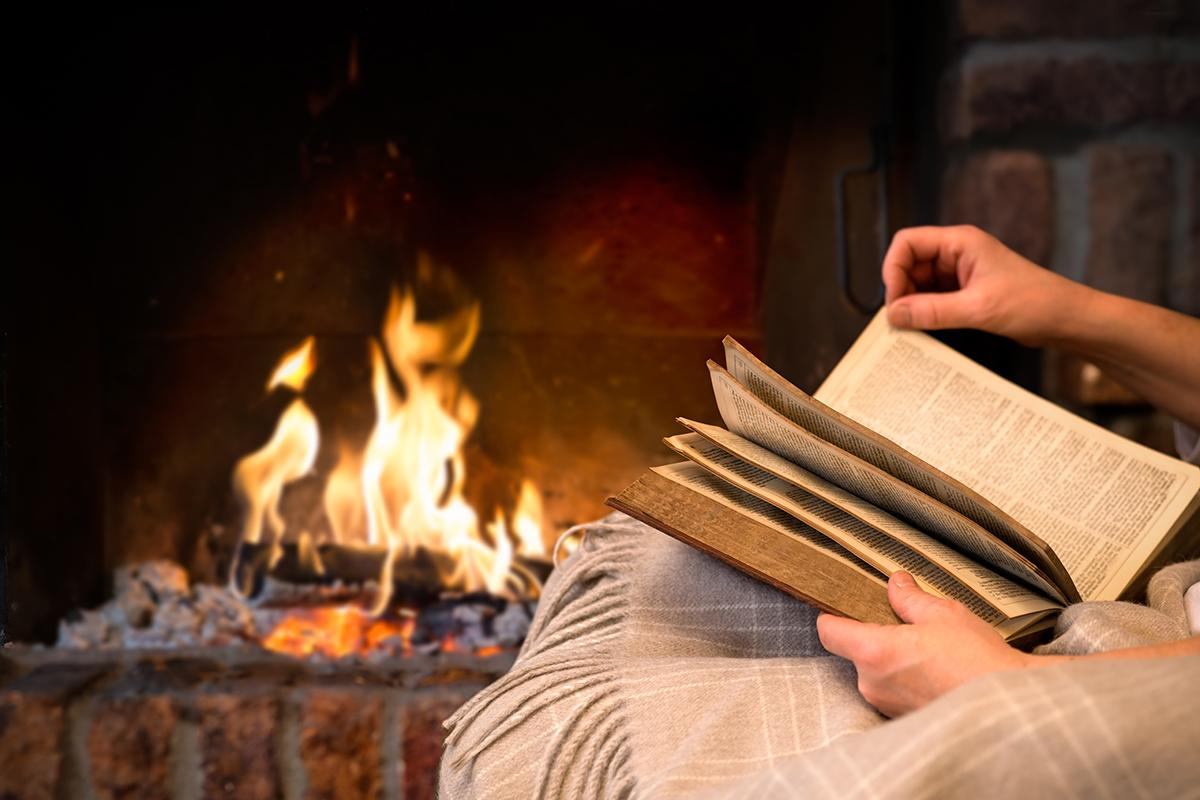 Reading book by fireplace.jpg