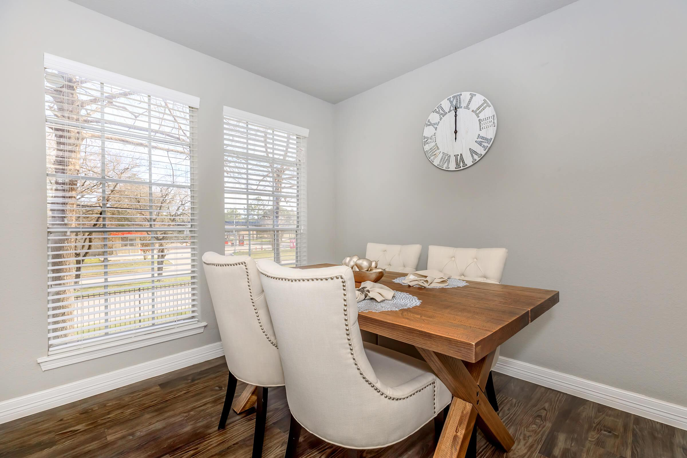 a living room with a clock on a table