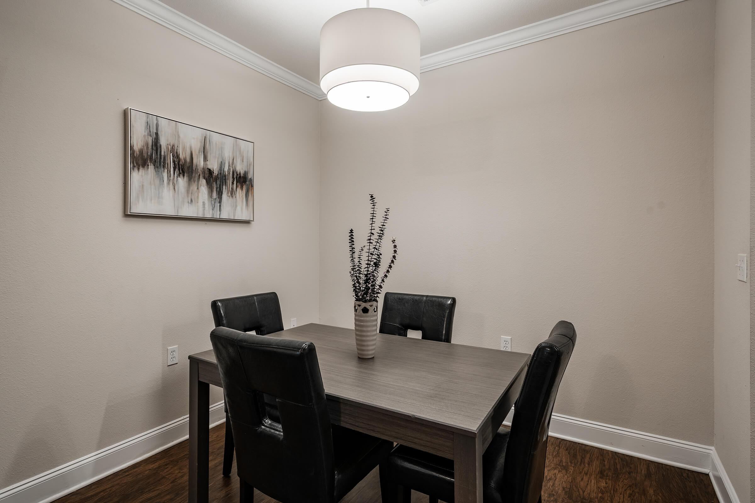 a dining room table in front of a mirror