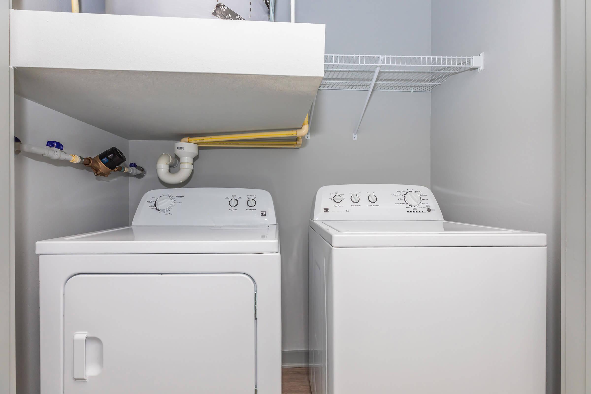 a refrigerator freezer sitting next to a sink