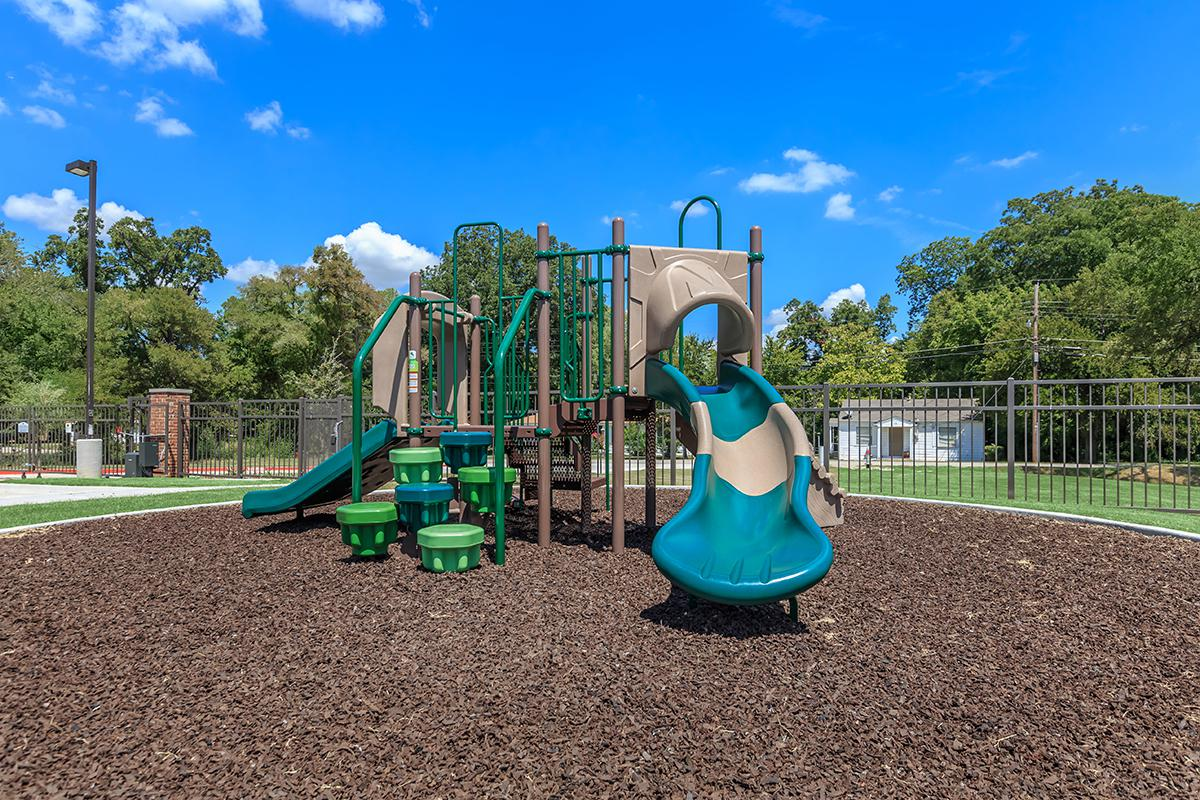 a playground in front of a green field