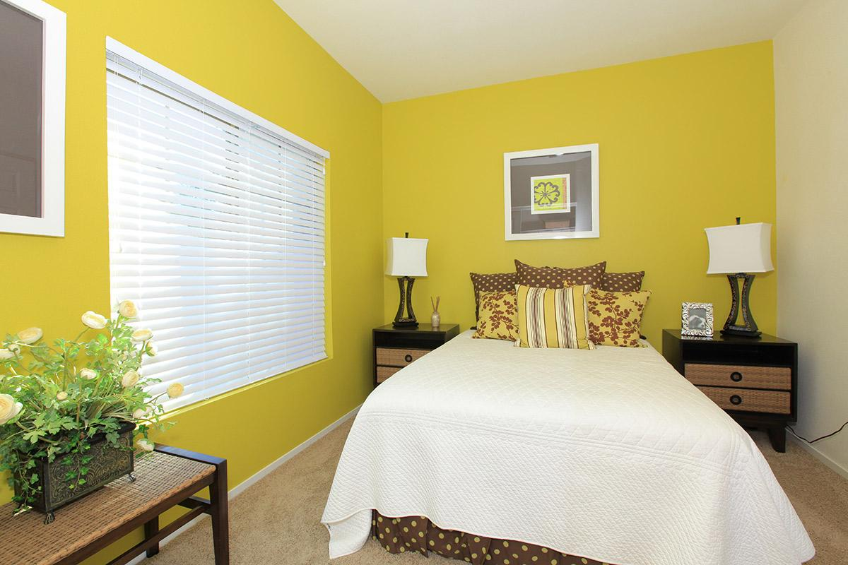 a yellow bed in a hotel room