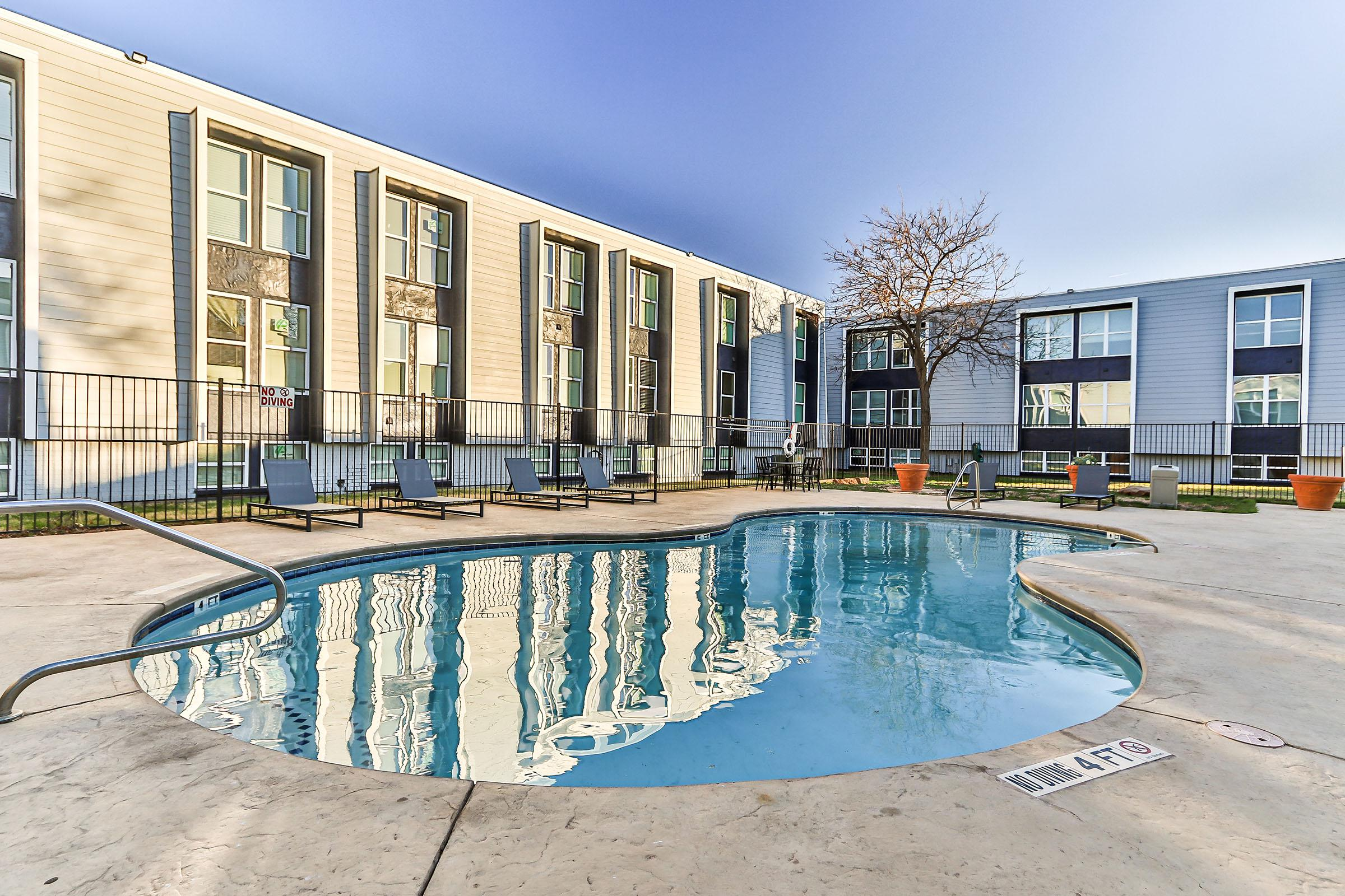 a pool next to a building
