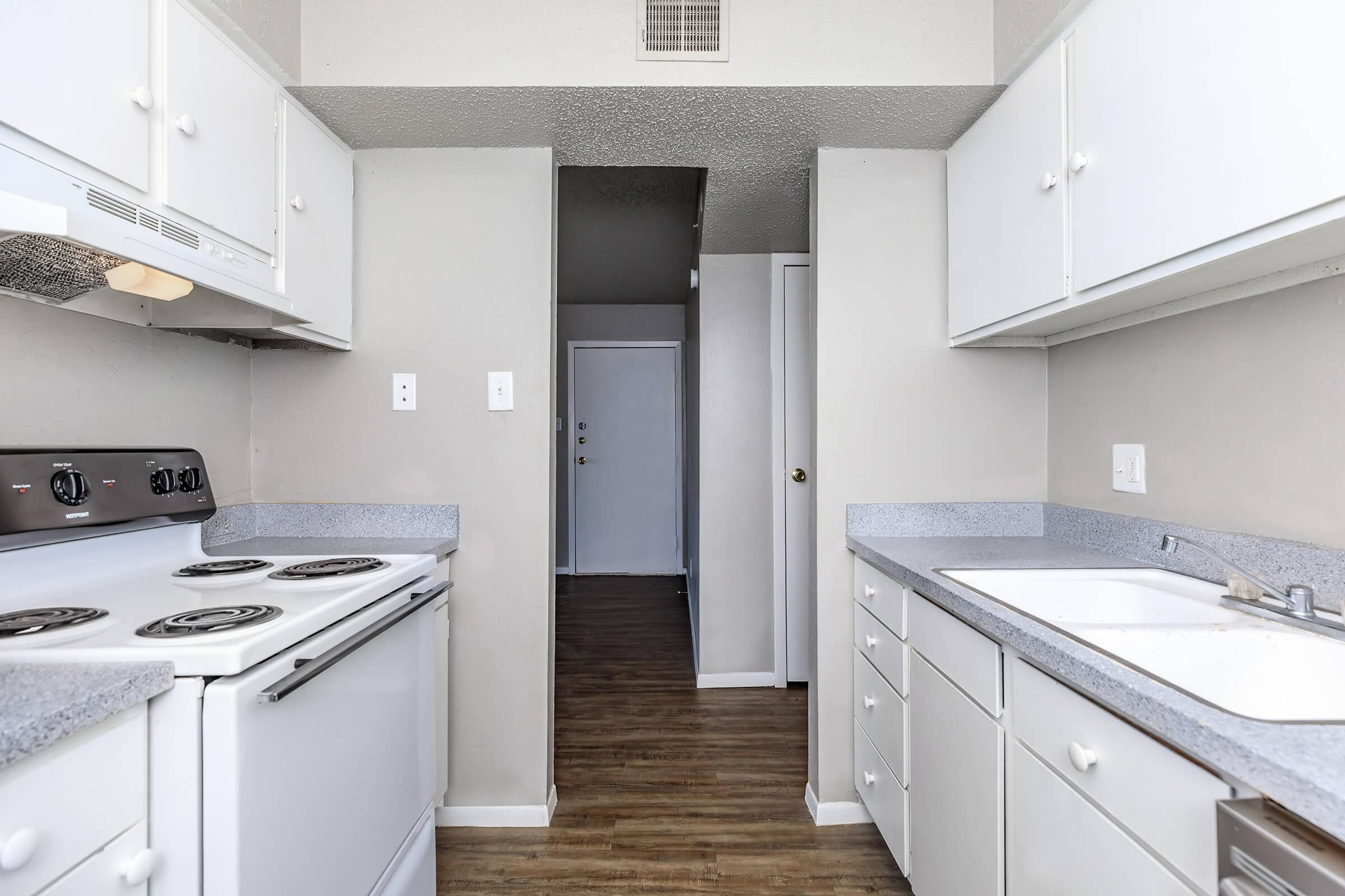 a kitchen with a sink and a stove top oven