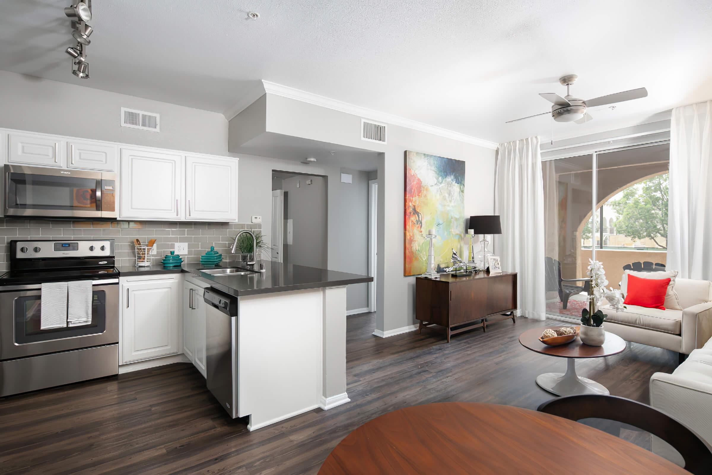Kitchen and living room with wooden floors