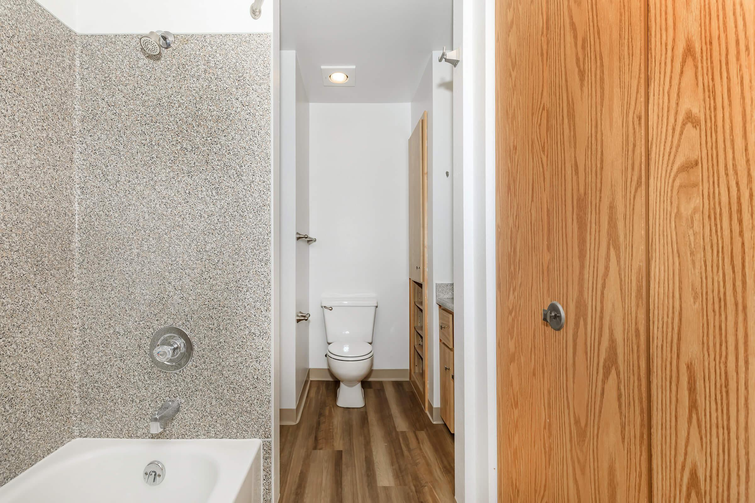 a close up of a door next to a shower