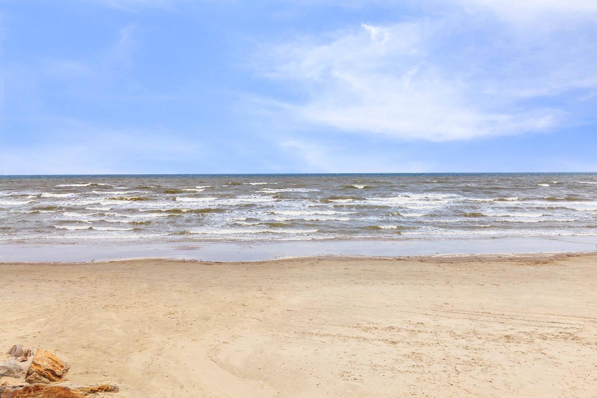 a close up of a sandy beach