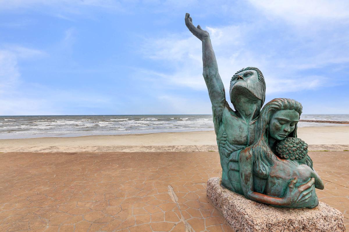 a statue on a beach