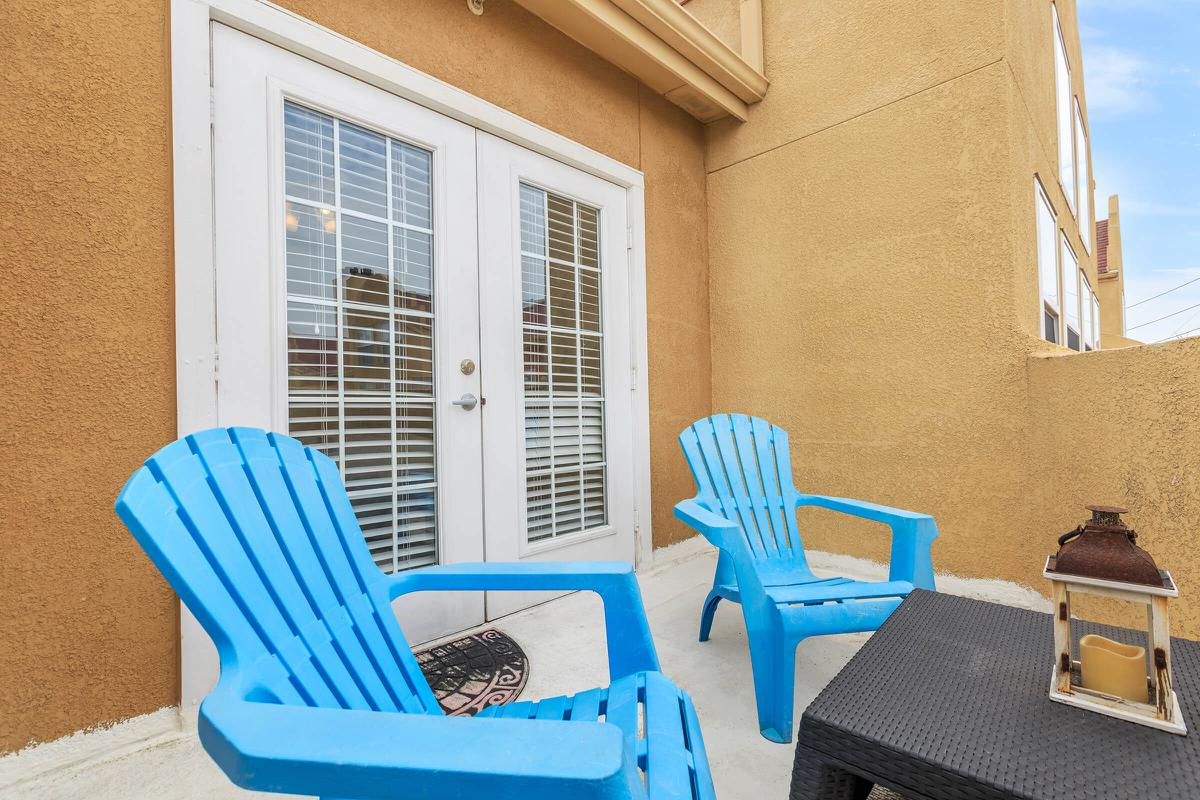 a blue chair sitting in front of a window
