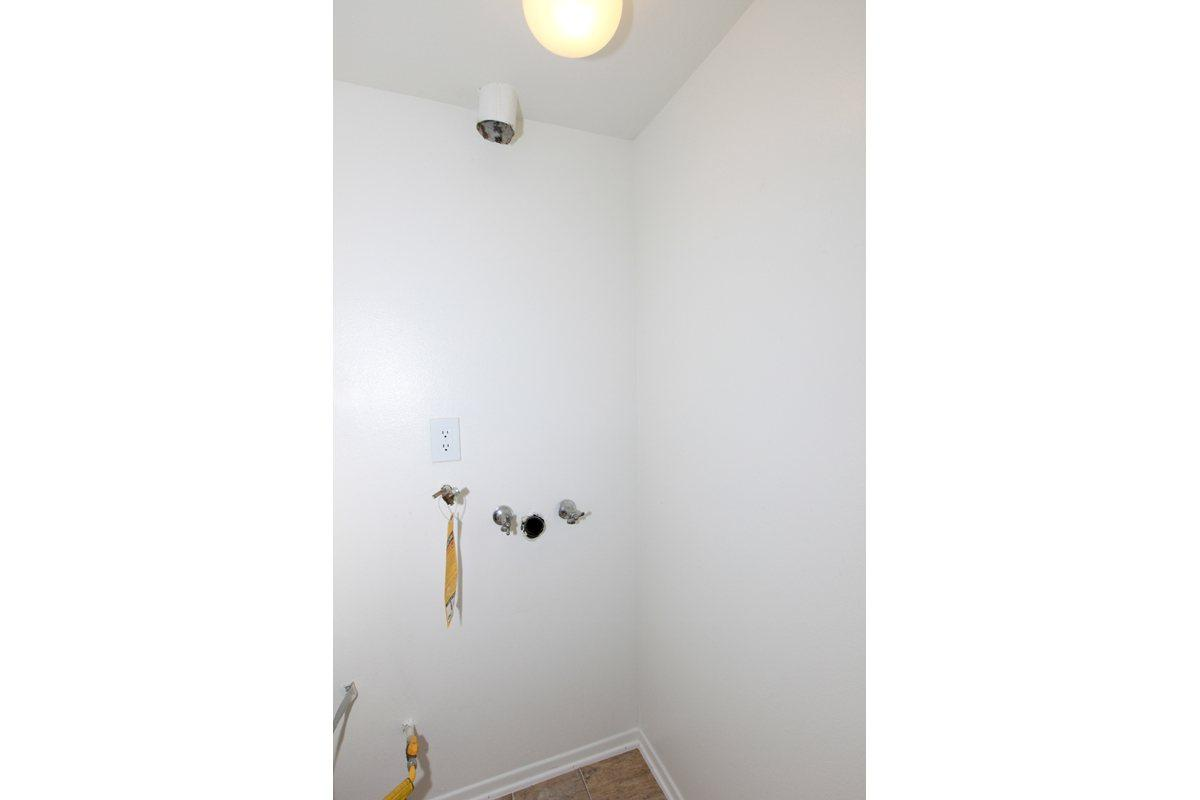 a white sink in a small room
