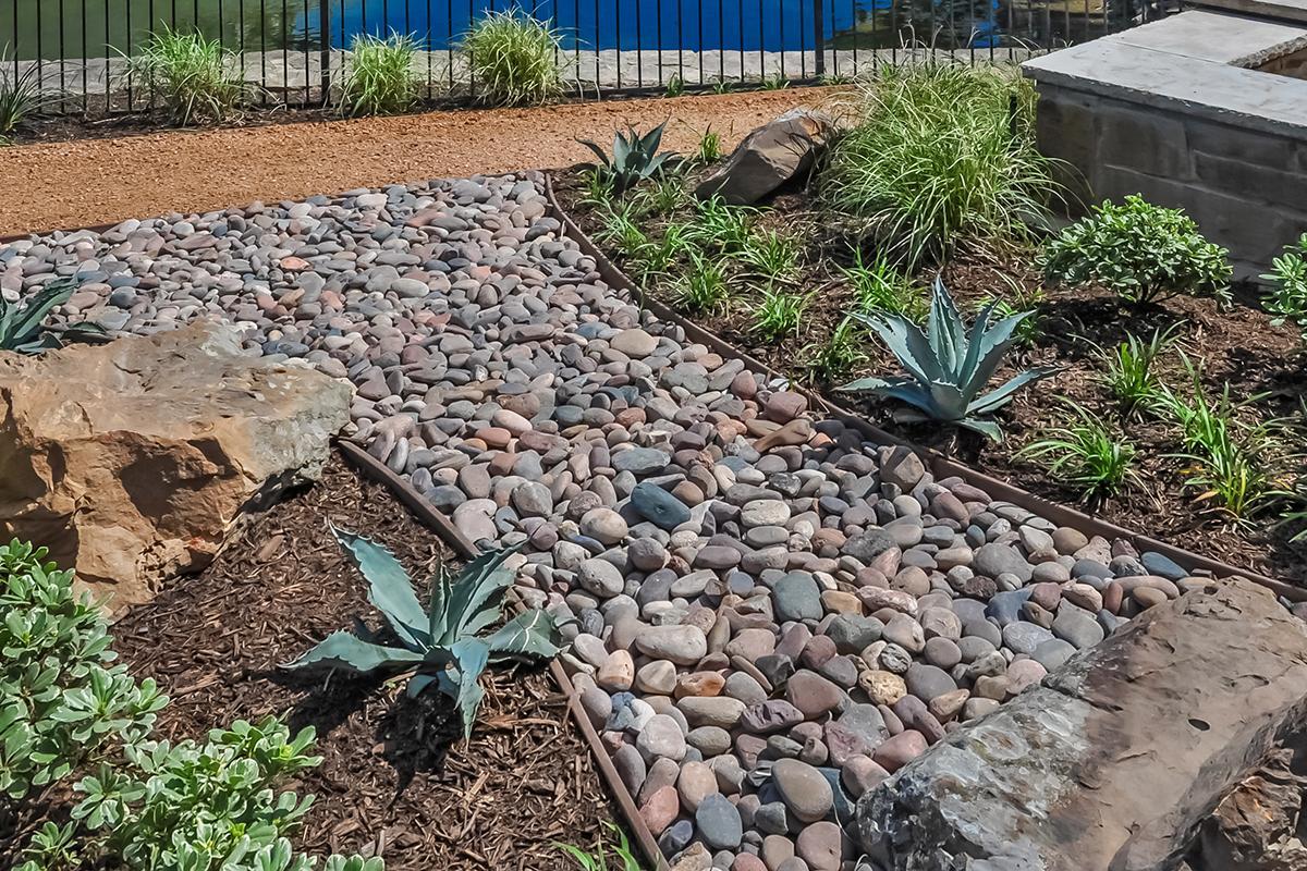 a pile of dirt in a garden