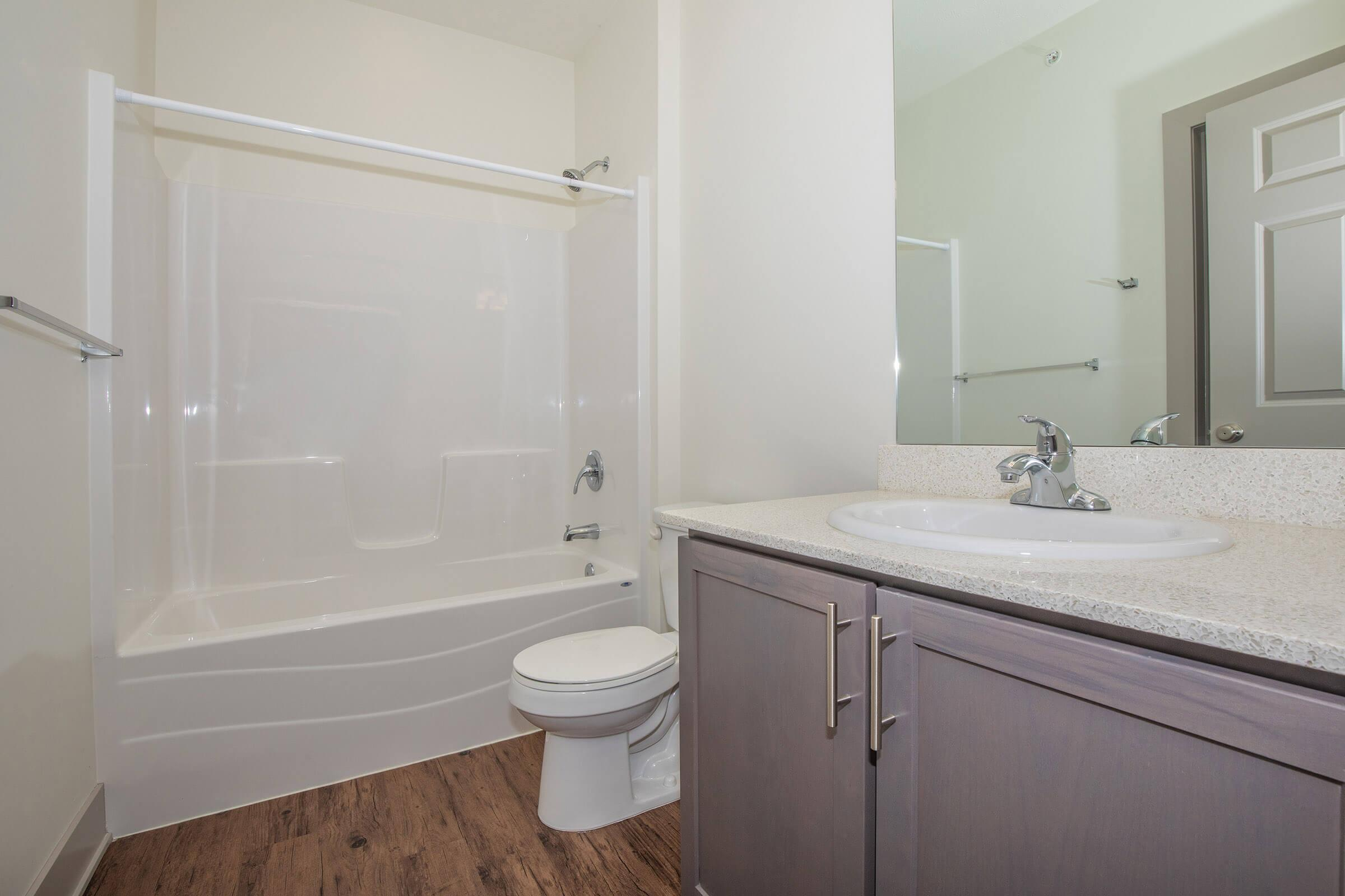 a room with a sink and a shower