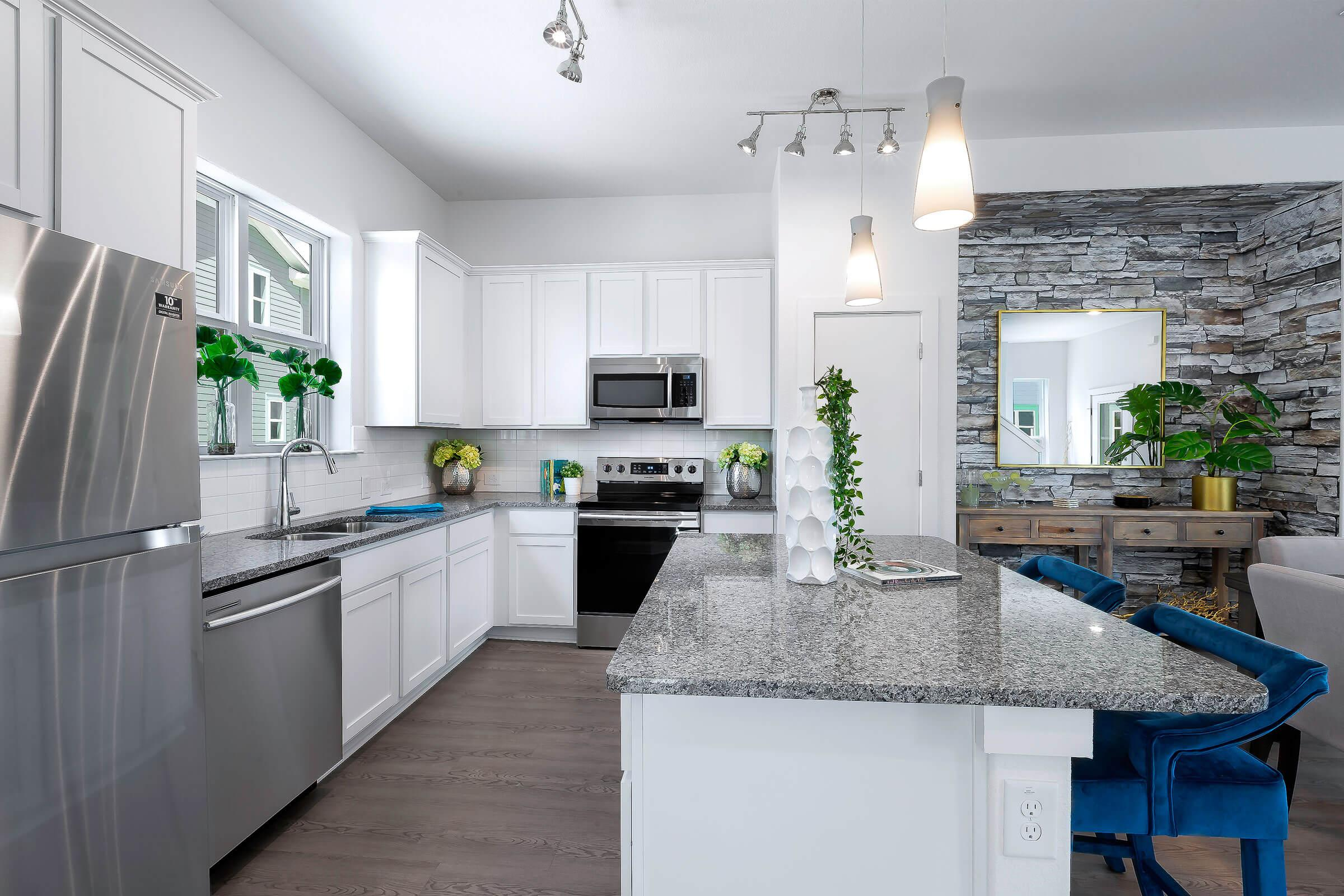 a modern kitchen with white cabinets