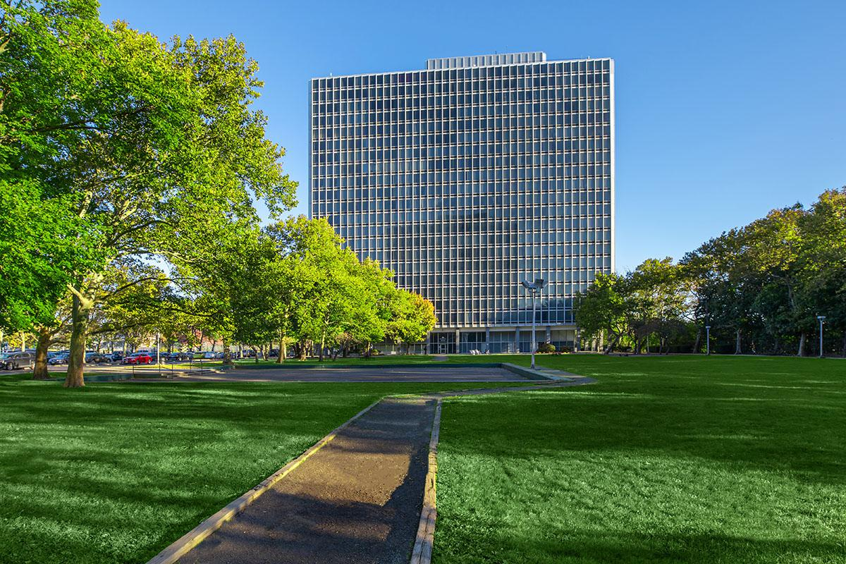 a building with a grassy field