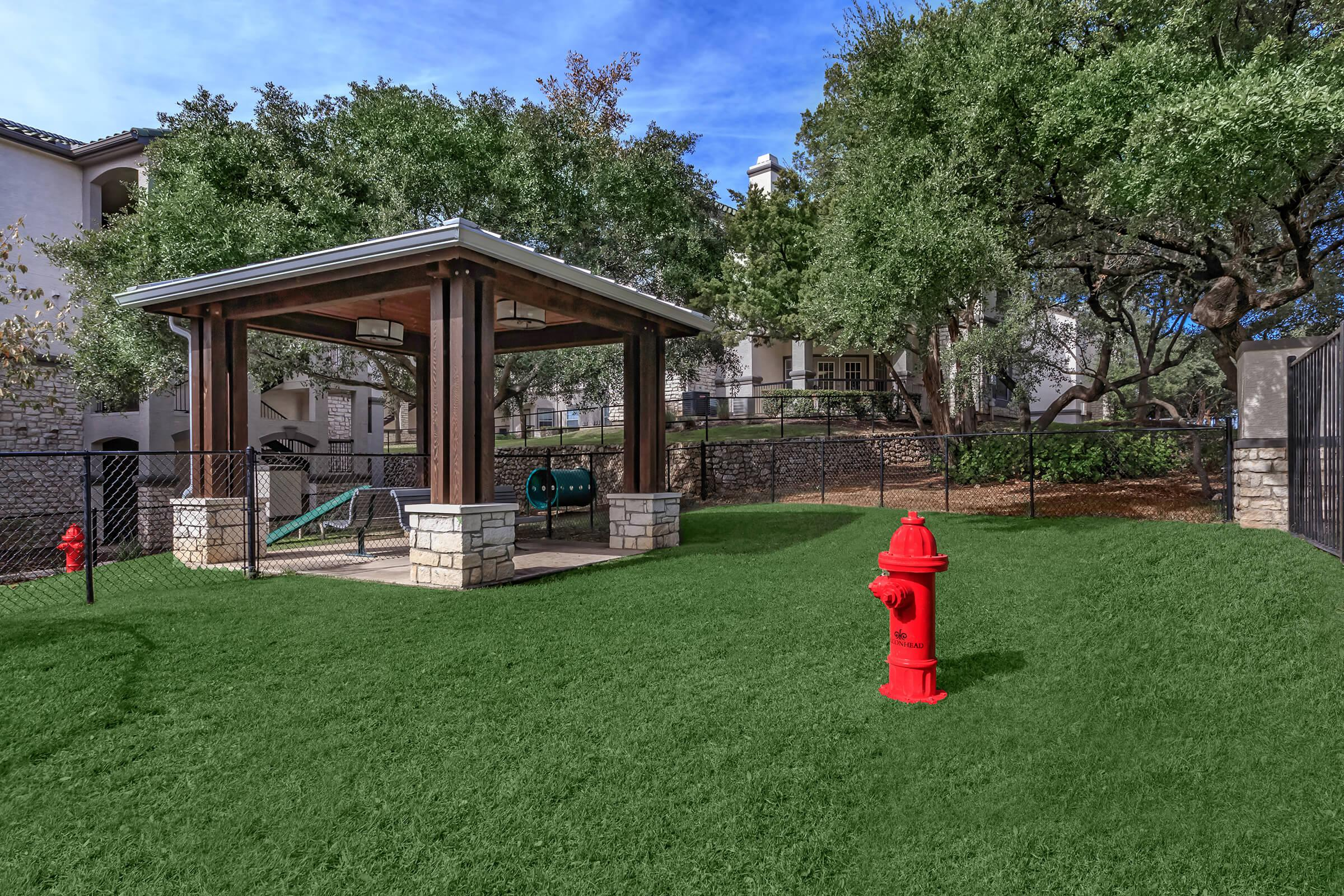 a red fire hydrant in front of a house
