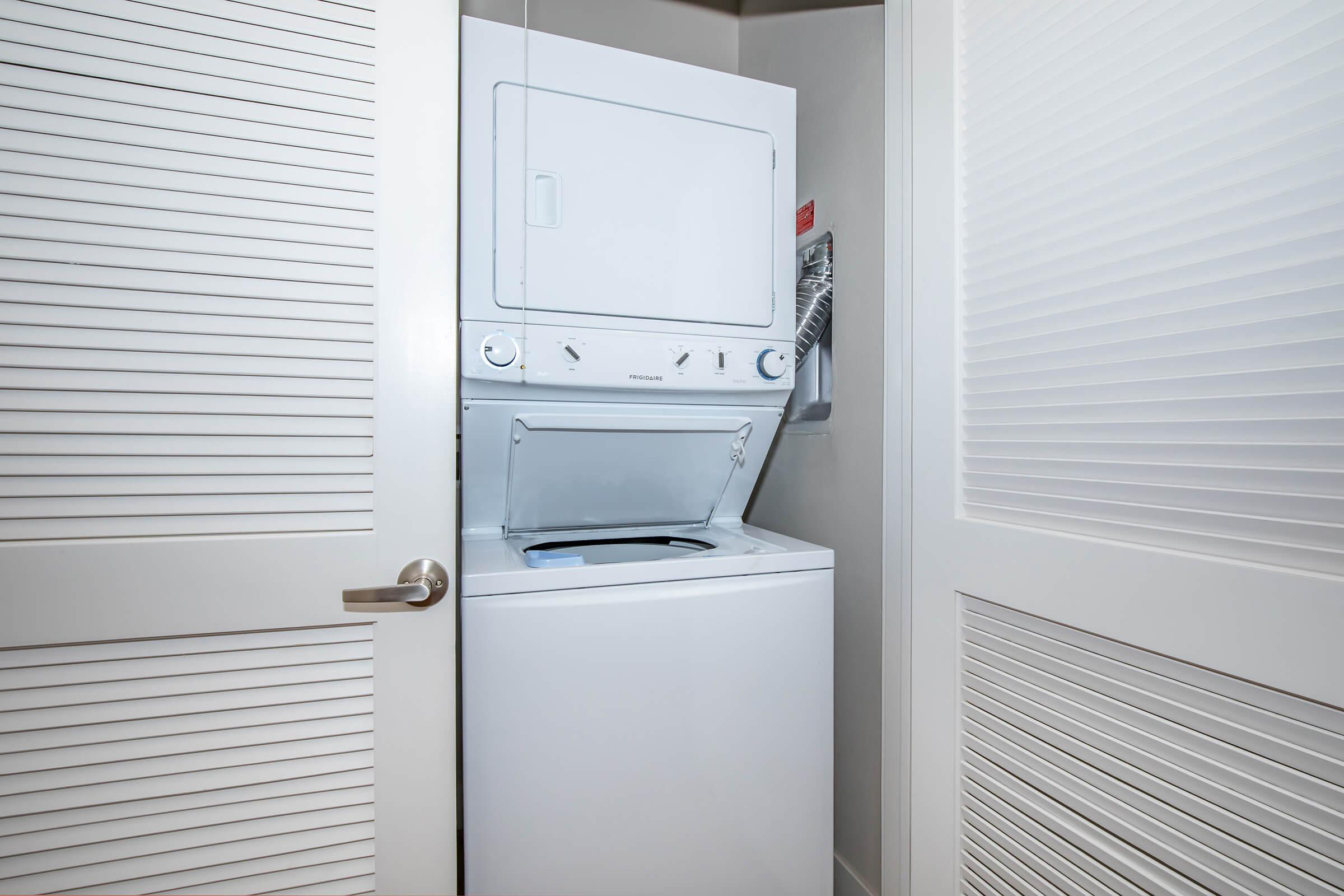 a white refrigerator freezer sitting next to a window