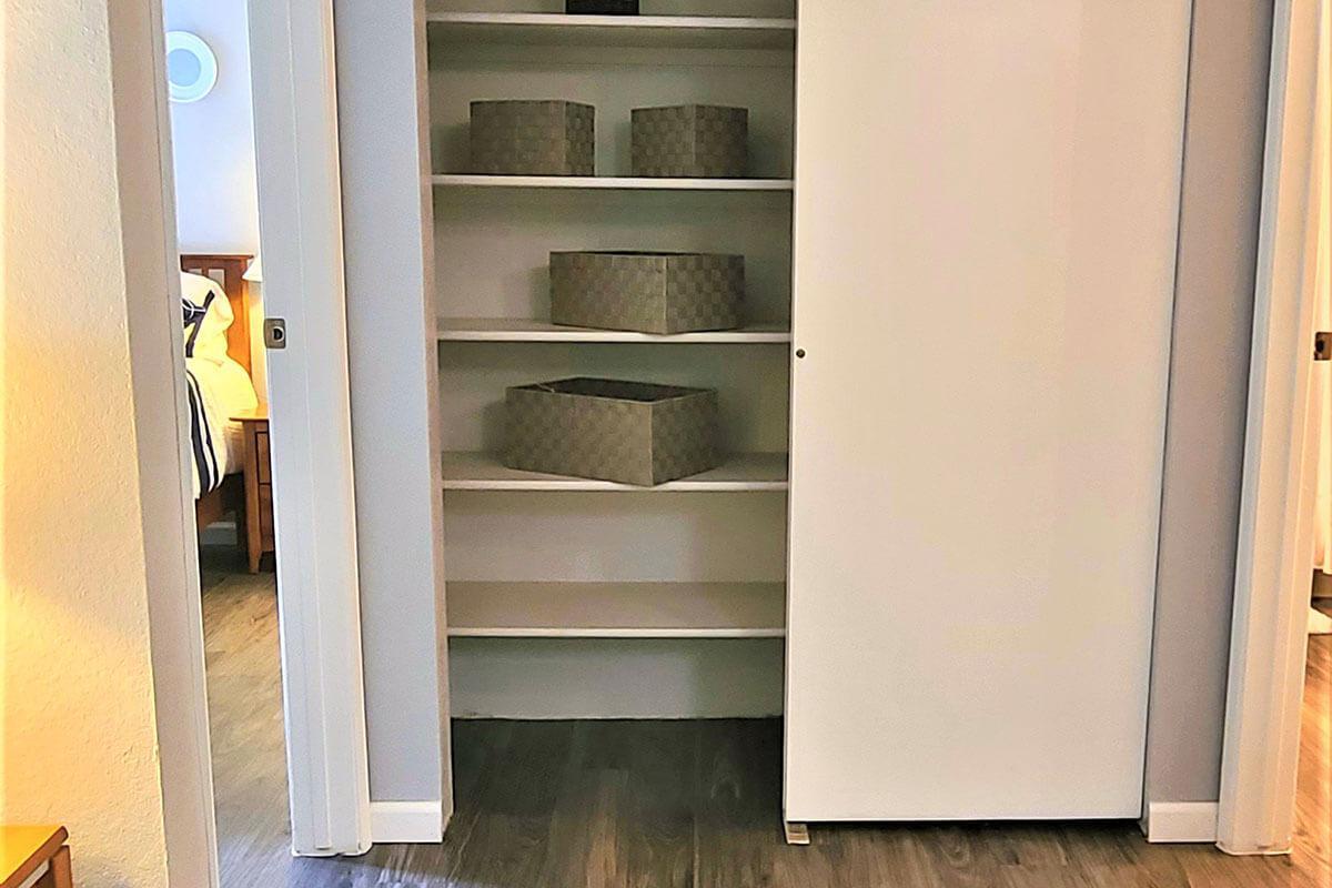 a refrigerator freezer sitting next to a door