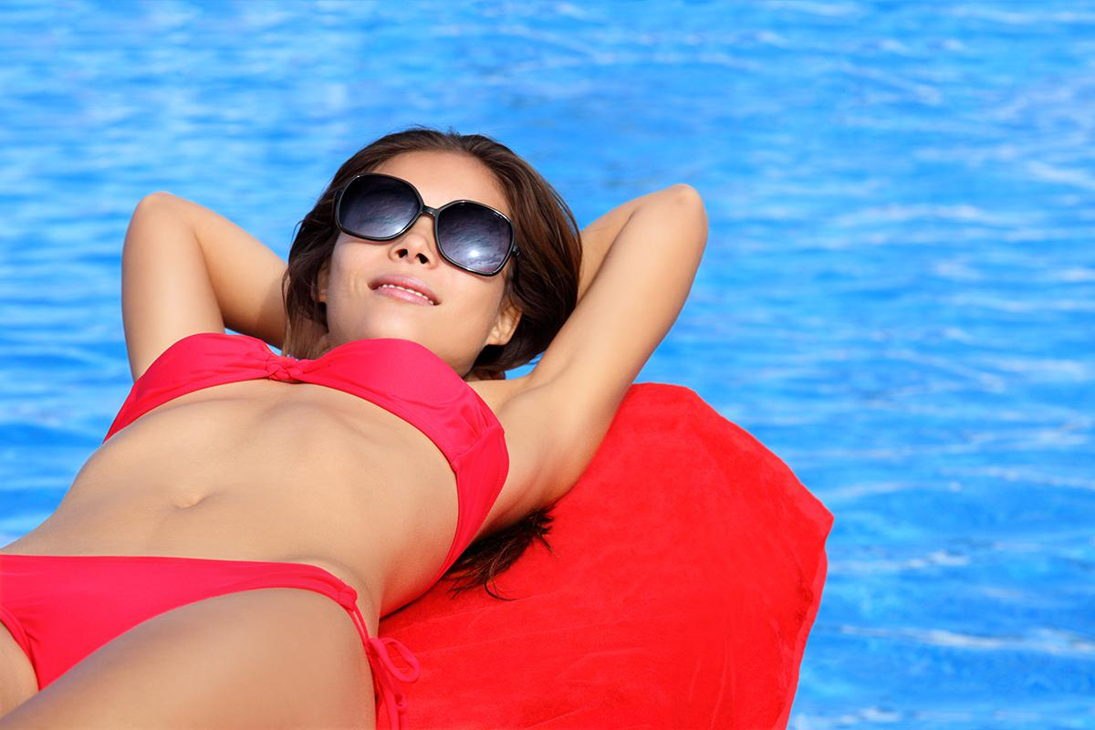 a woman wearing sunglasses in a body of water
