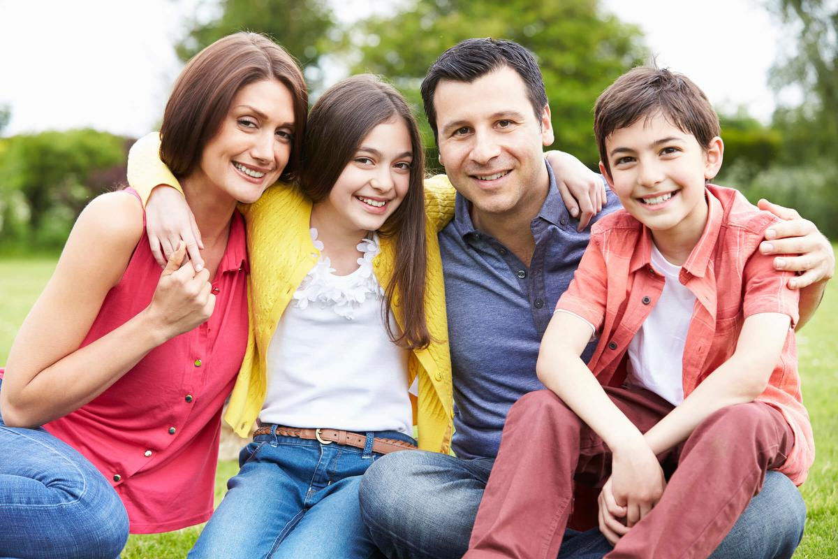 Portrait Of Hispanic Family In Countryside iStock_000033922802_Double.jpg