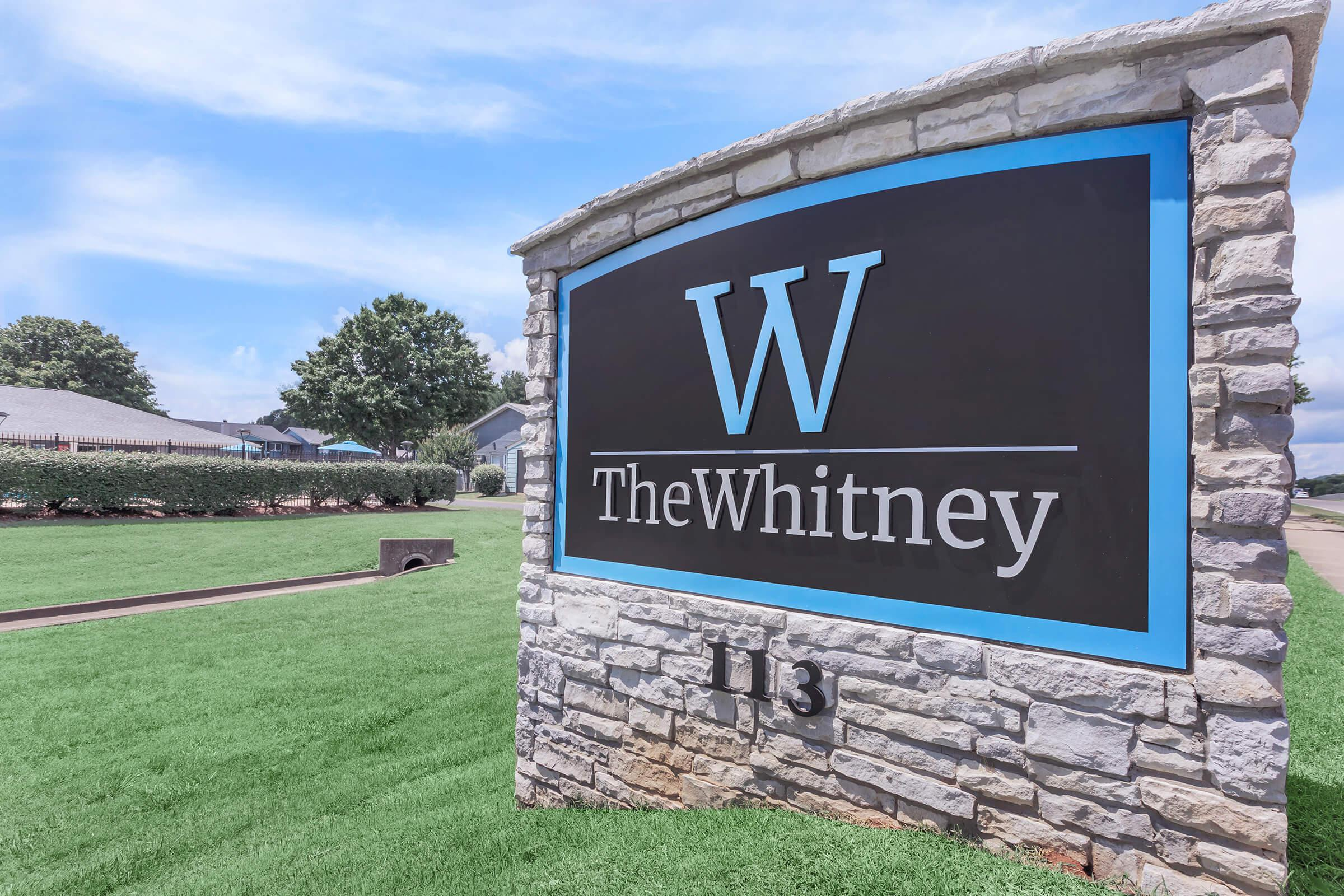 a blue and white sign