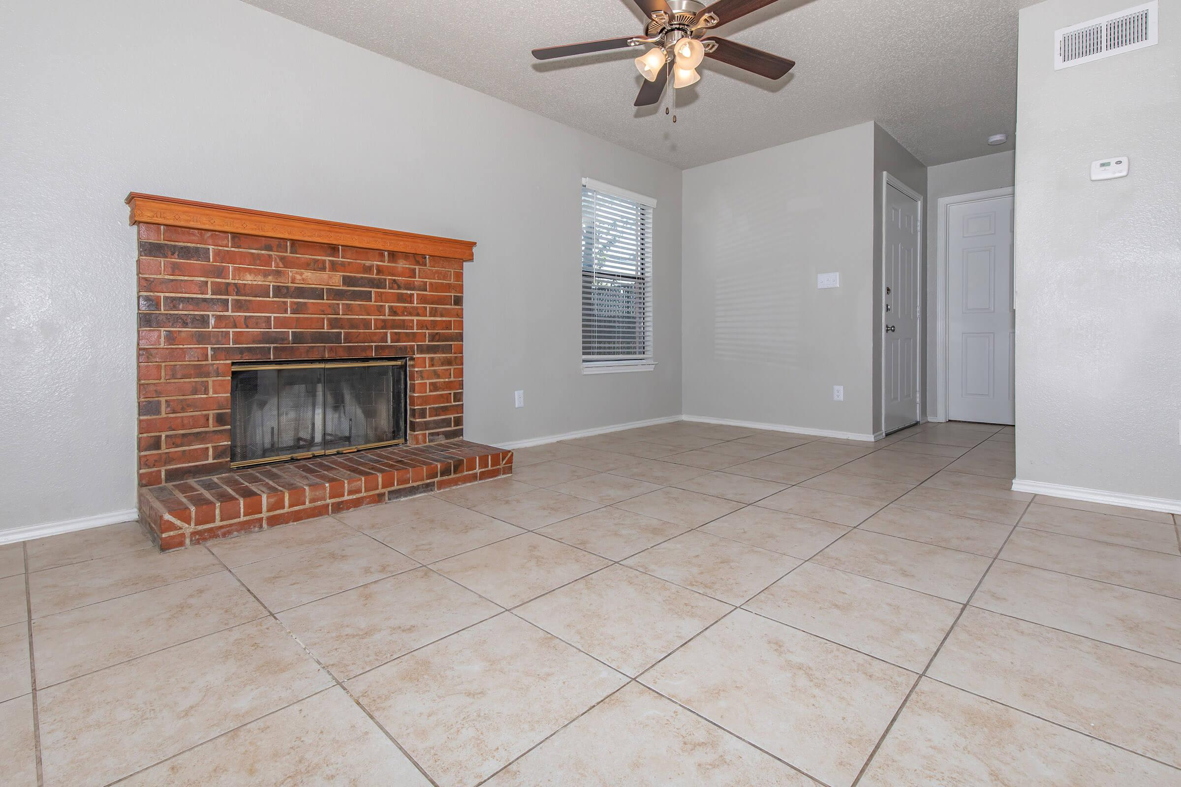 a fire place sitting in a room