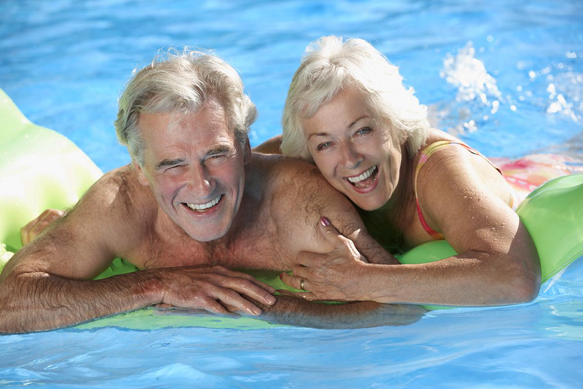 a man and woman swimming in the water