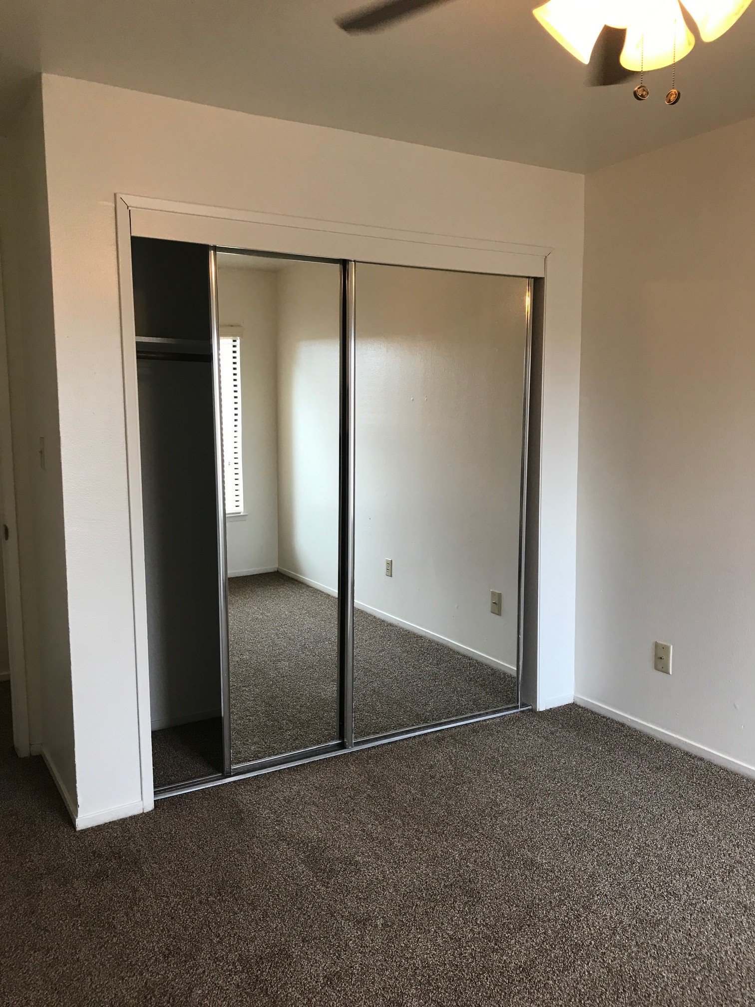 a room with a large mirror