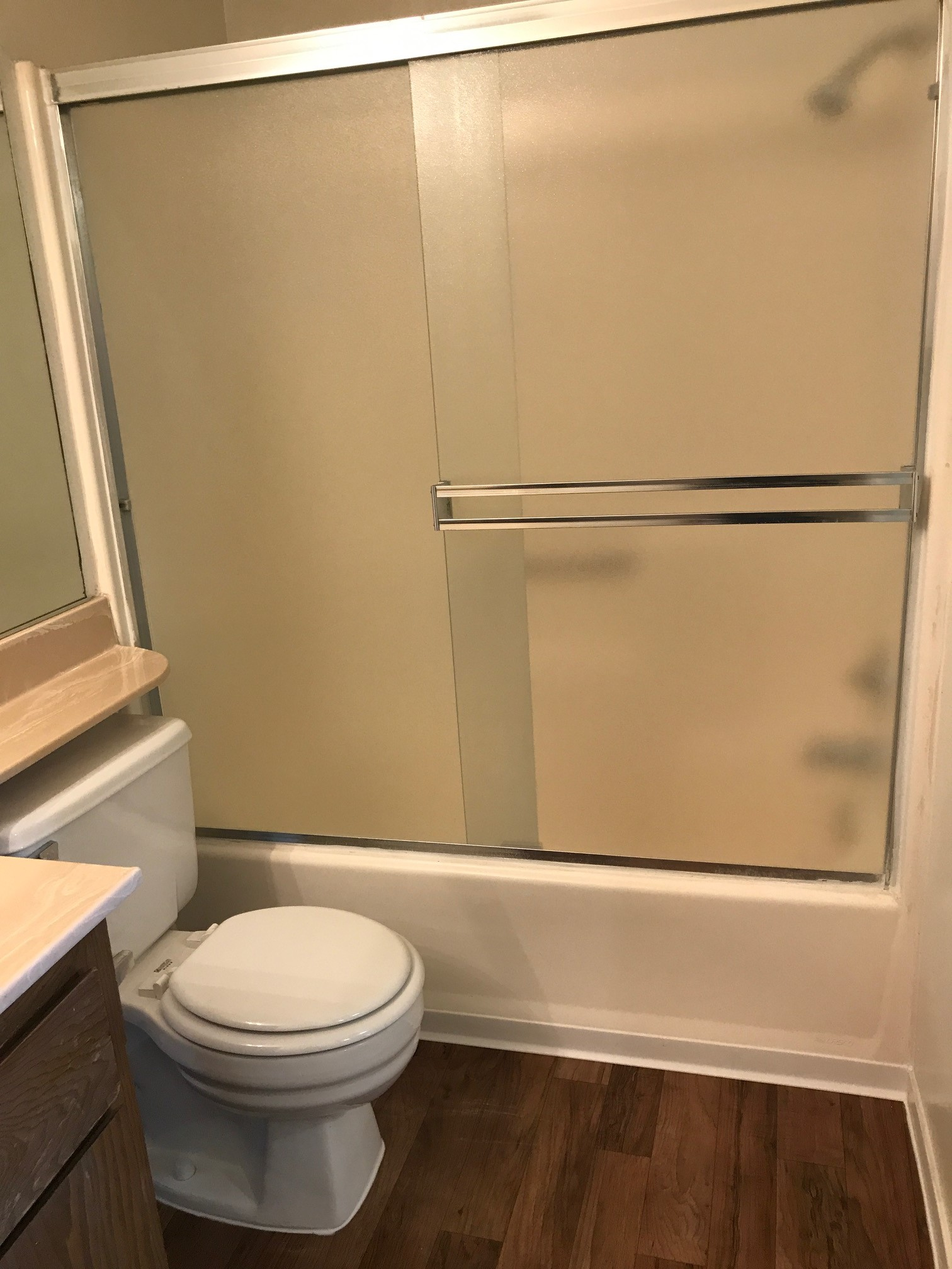 a white tub sitting next to a sink