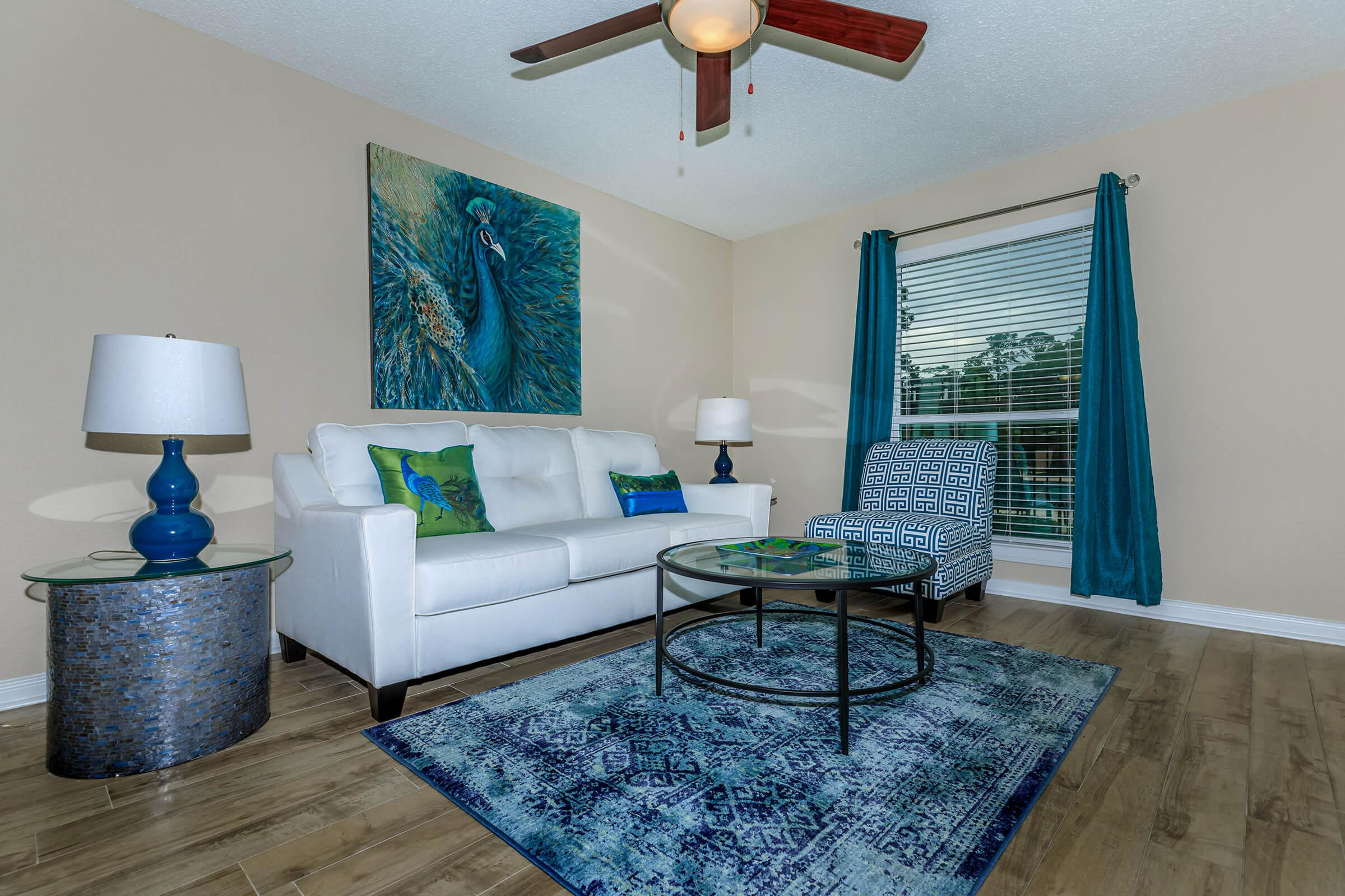 YOUR NEW LIVING ROOM AT MONTABELLA AT OAK FOREST APARTMENTS