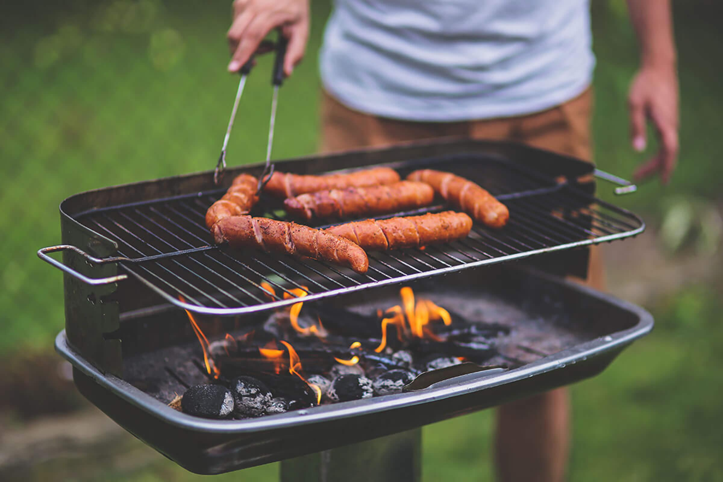 a person cooking food on a grill