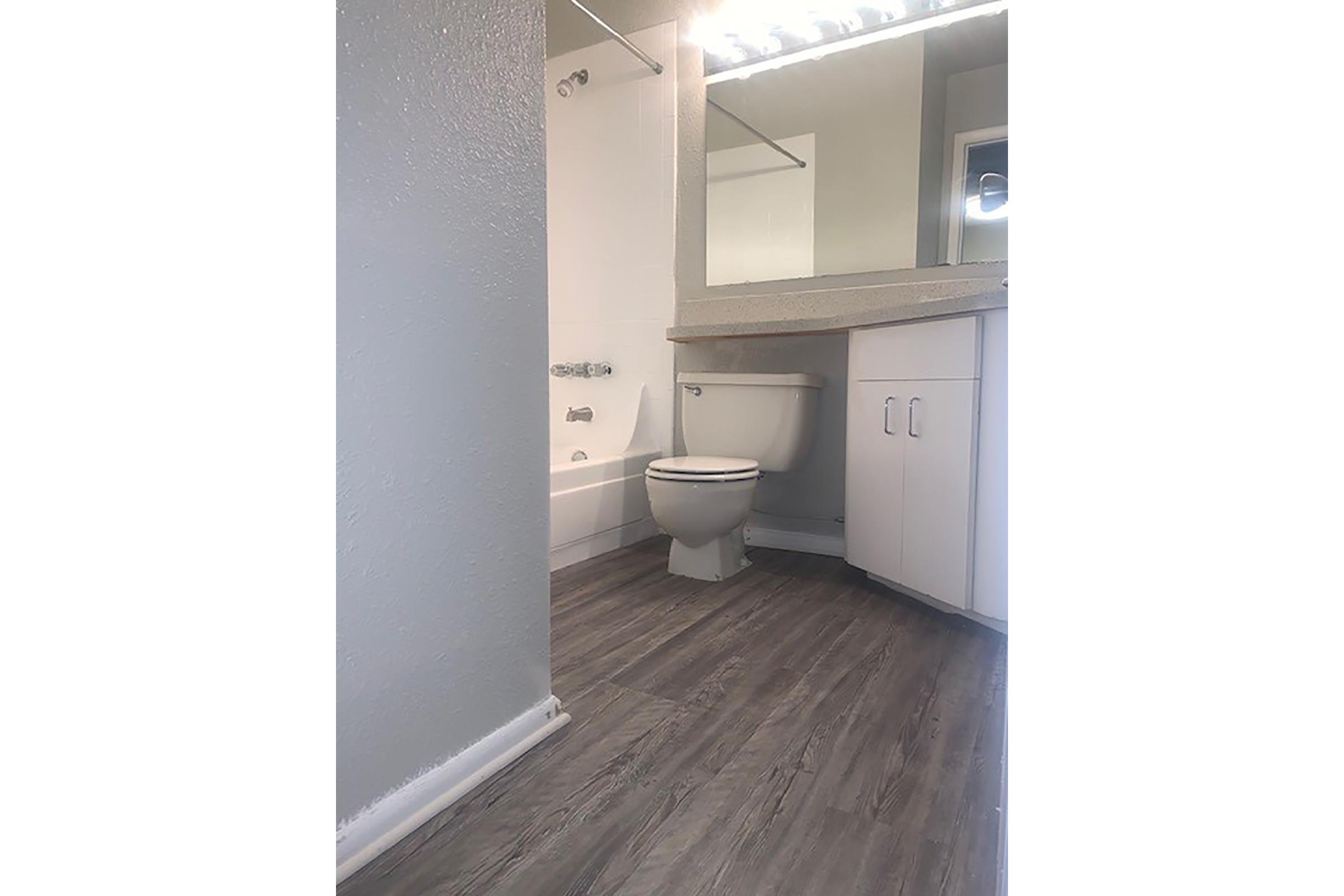 a white sink sitting next to a building