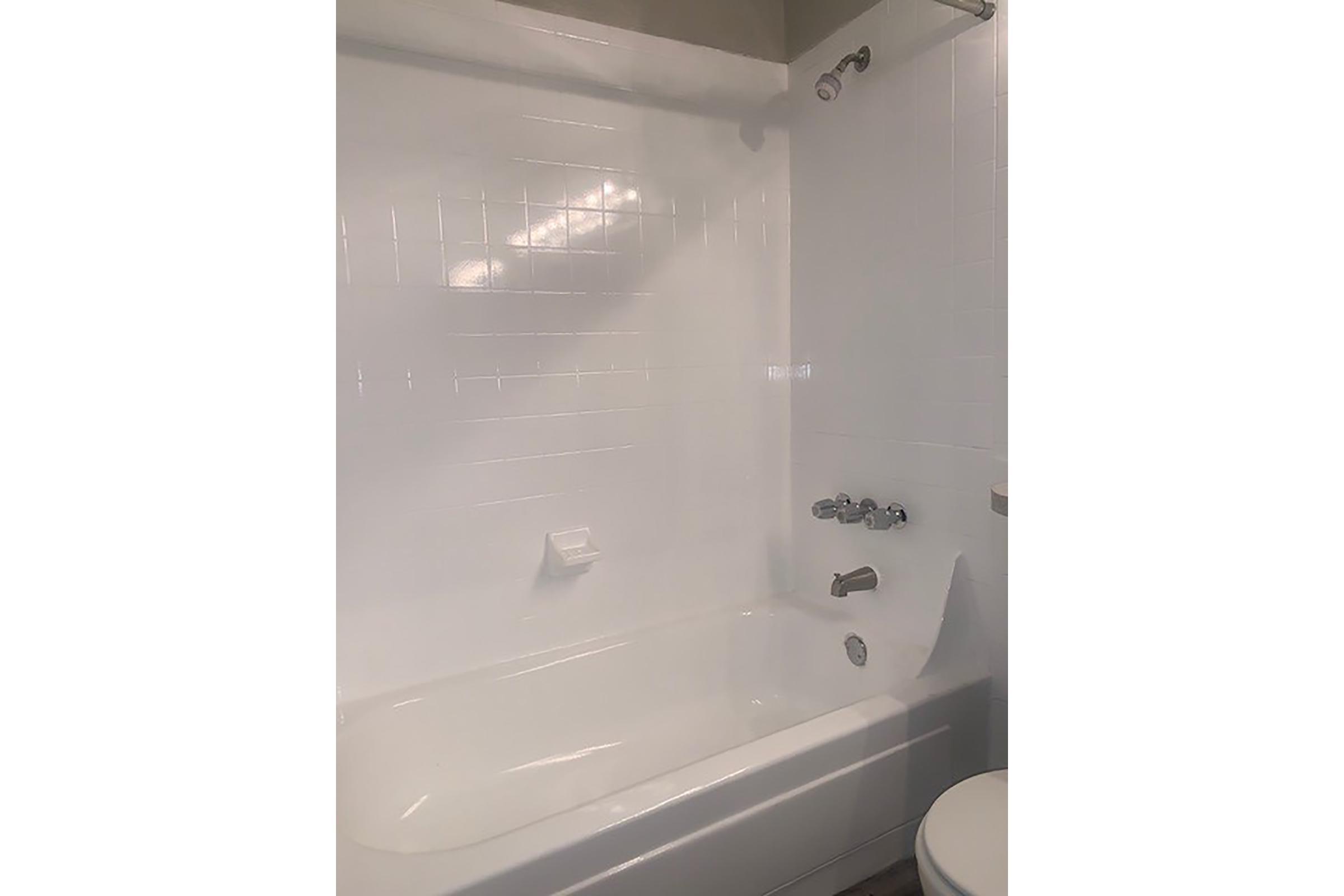 a white tub sitting next to a wall