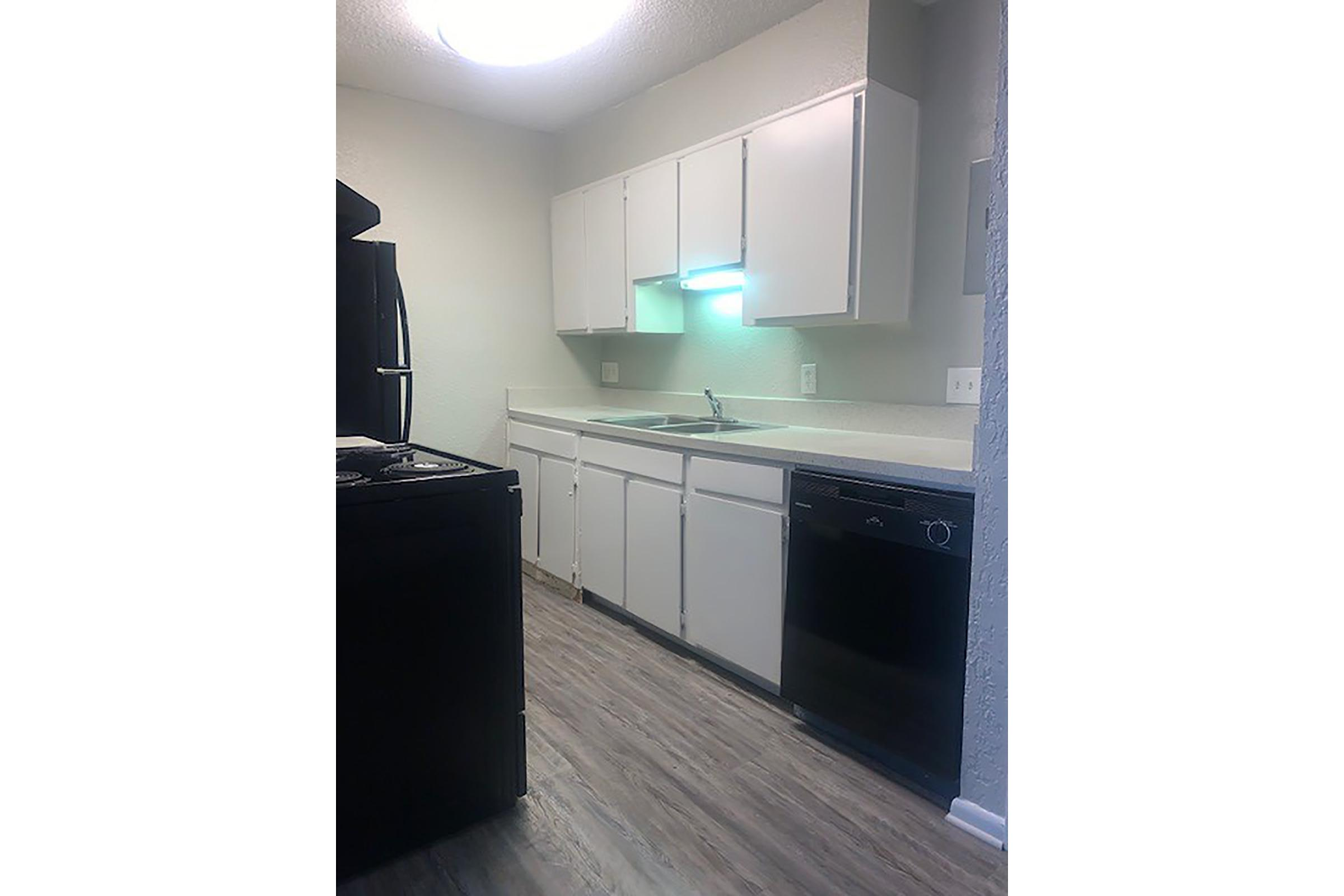 a kitchen with a black background