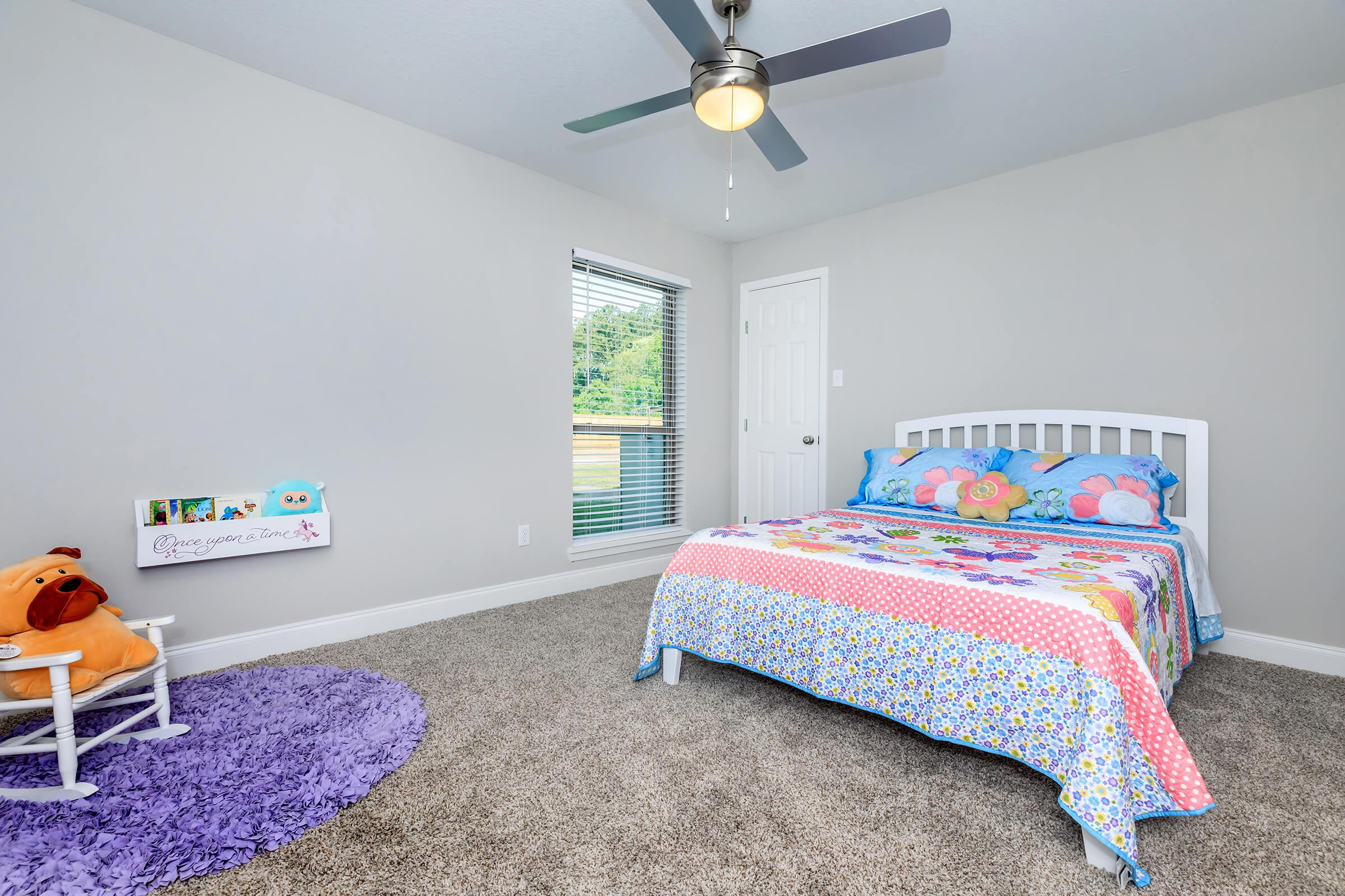 a bedroom with a toy in a room