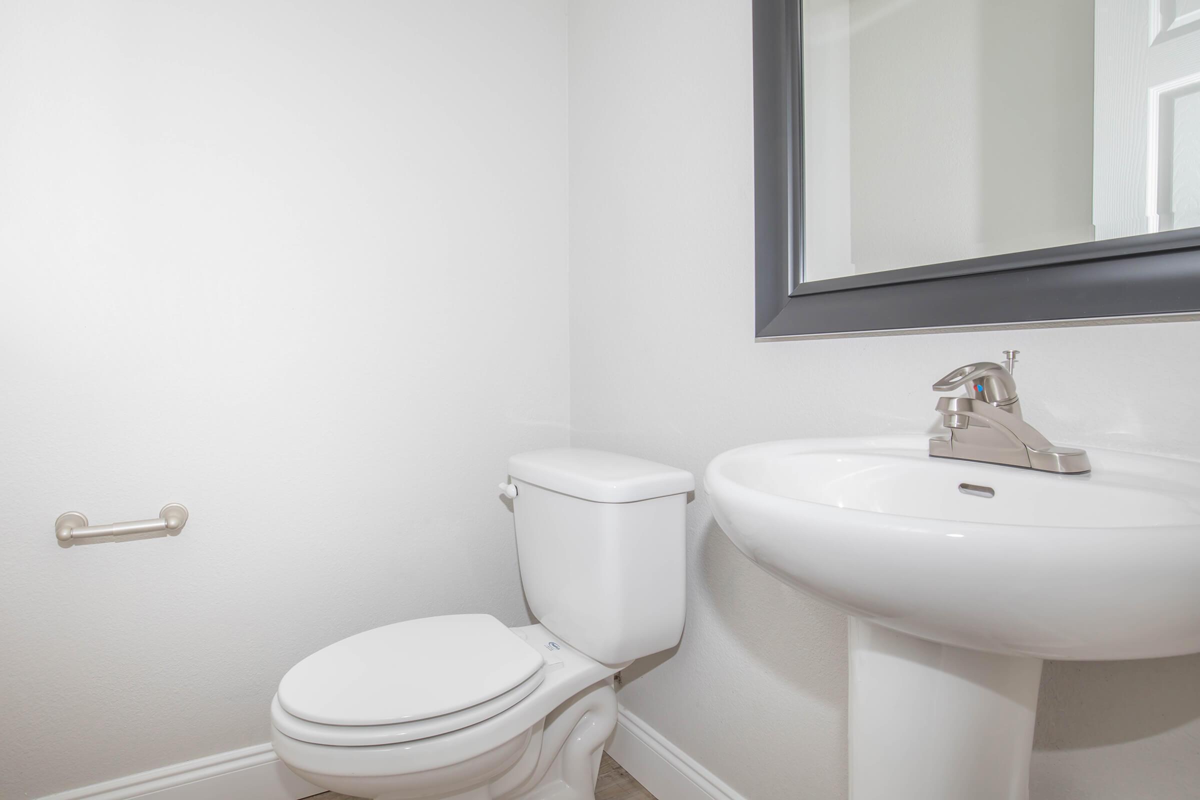 a white sink sitting next to a window