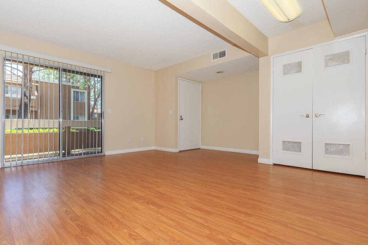 a large empty room with a hard wood floor