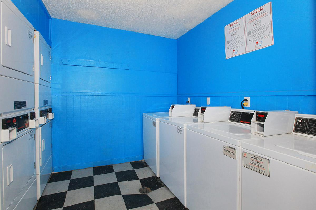 a kitchen with a blue and white tile