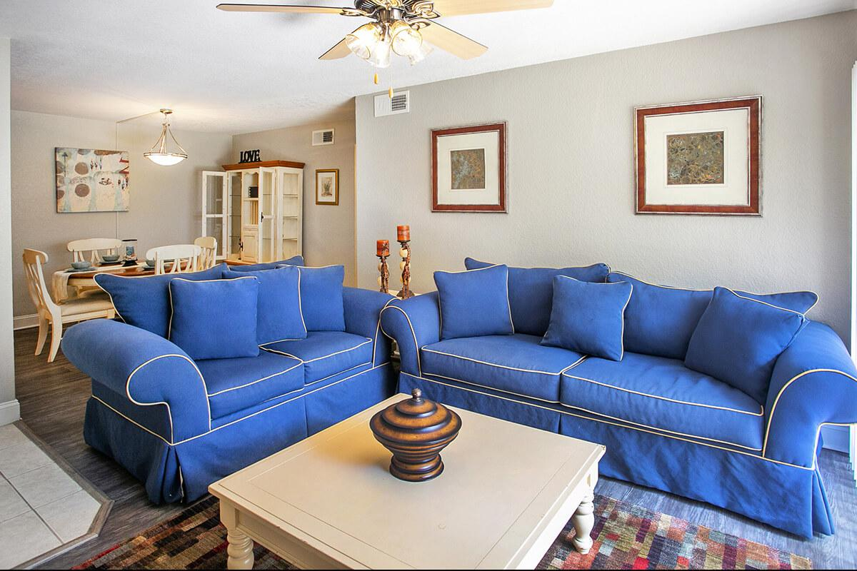 a living room with blue furniture